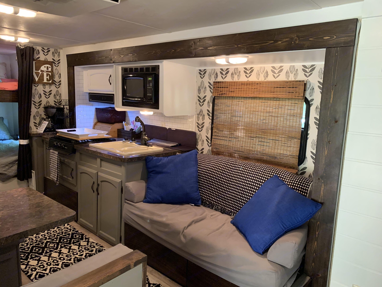 Jack Knife Sofa/Kitchenette Area.  Coffee maker included.. Forest River Salem Cruise Lite 2012