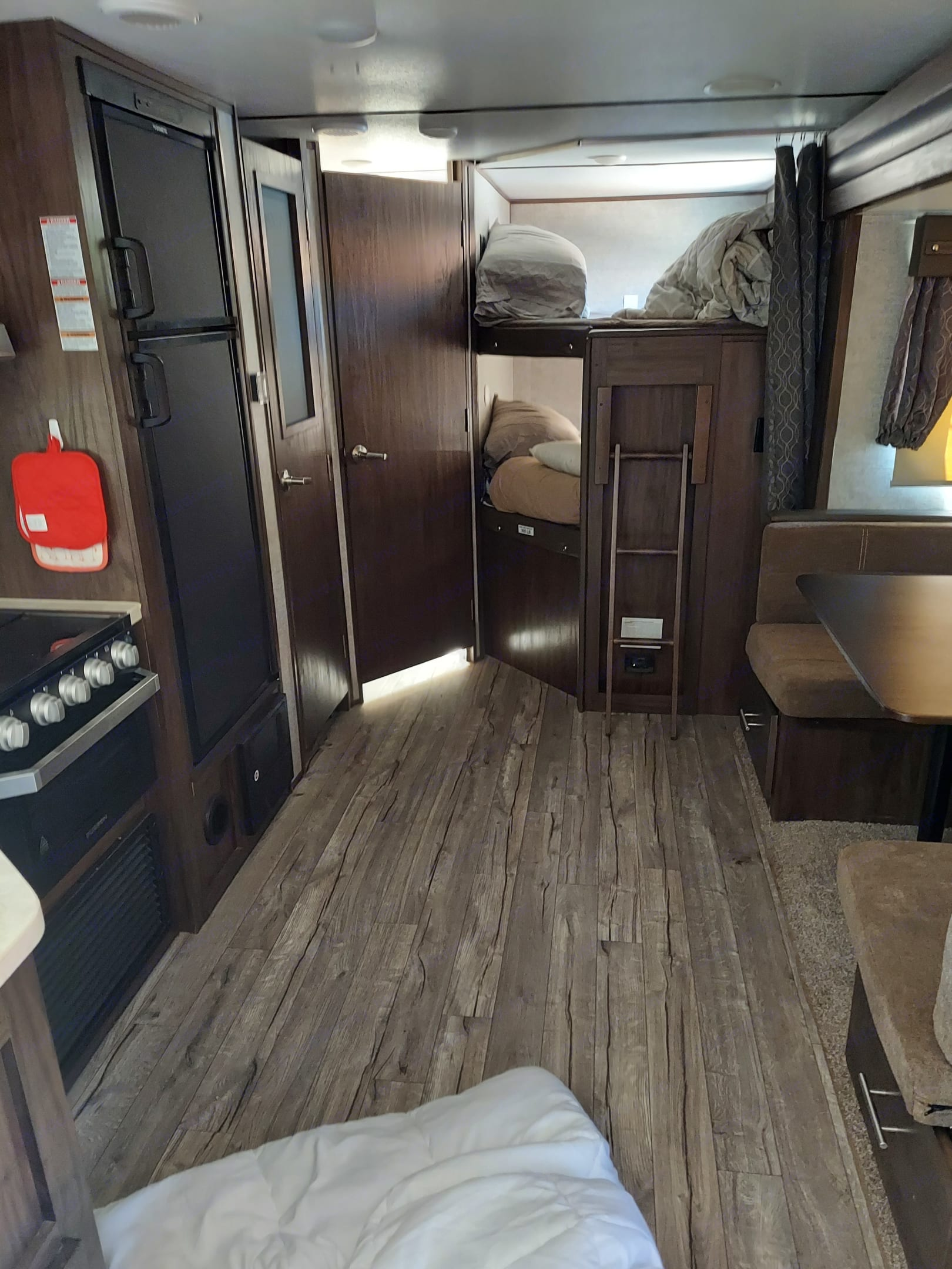 view of bunks and one couch that sleeps 2.. Forest River Cherokee alpha Wolf 2018