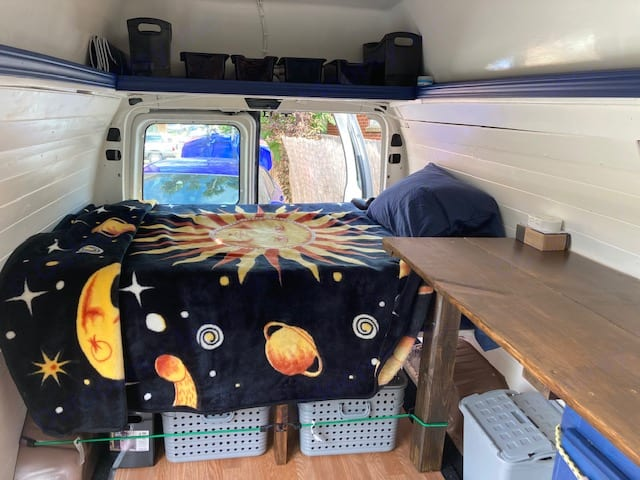 Inside with bed made and bins loaded (linens can be included). Ford E350 Box Van 1997