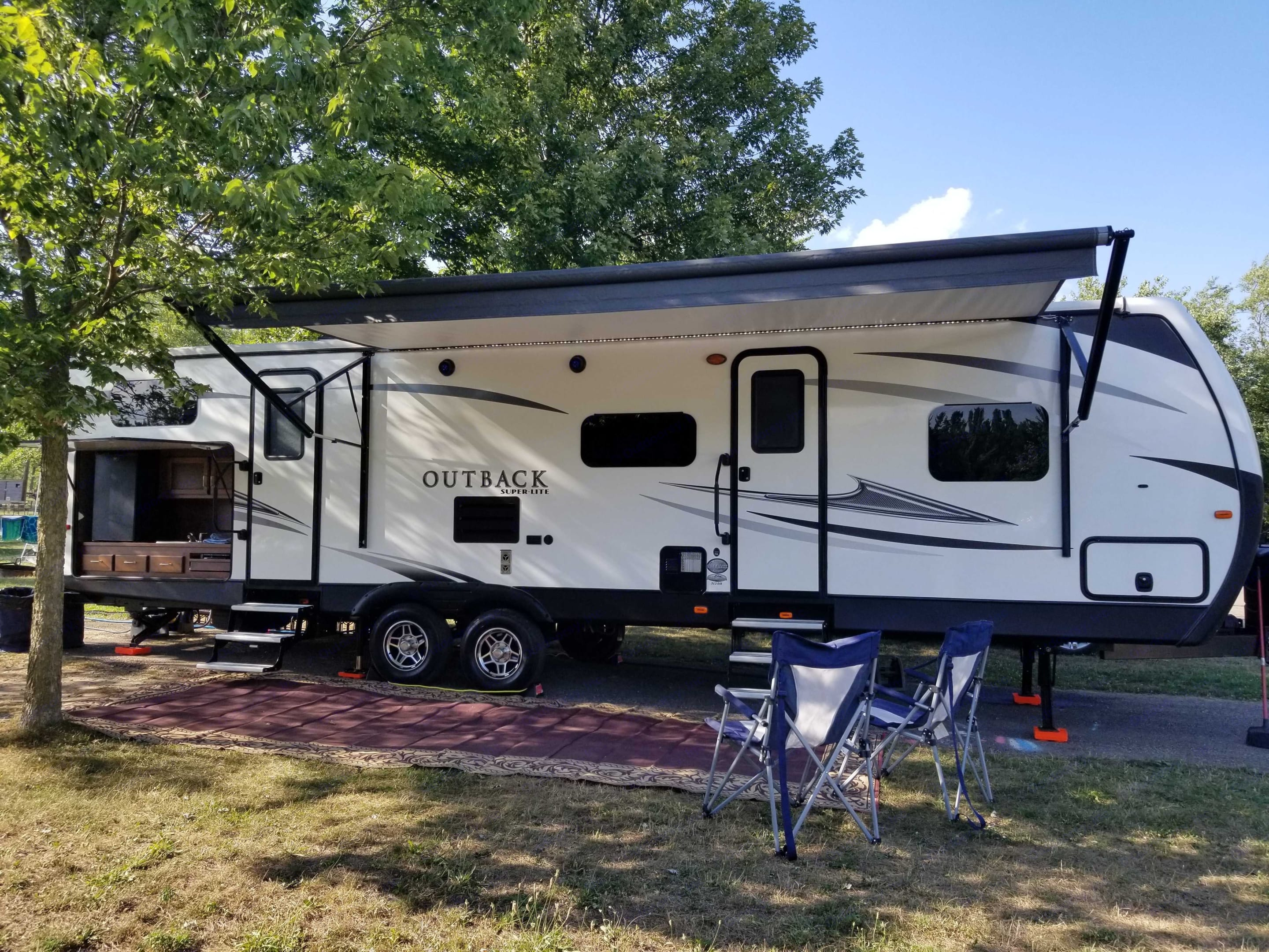 Full set up... including 18ft awning, outdoor rug, 2 trash cans & chairs... the super convenient out door kitchen with fridge, sink & 2 burner stove . Keystone Outback 2017