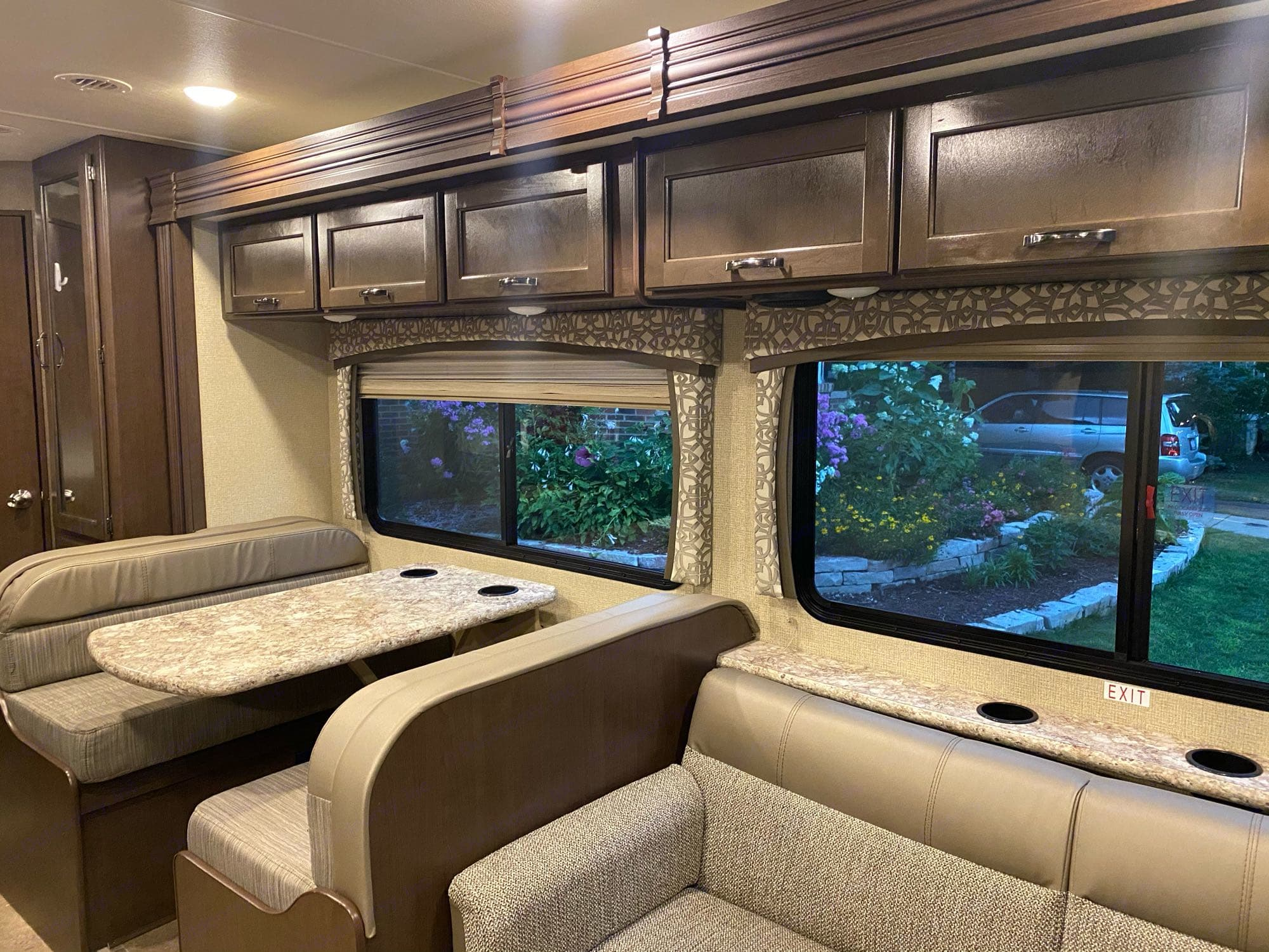Dinette and lounge. Both dinette and lounge turn into twin sized beds. . Thor Motor Coach Chateau 2018