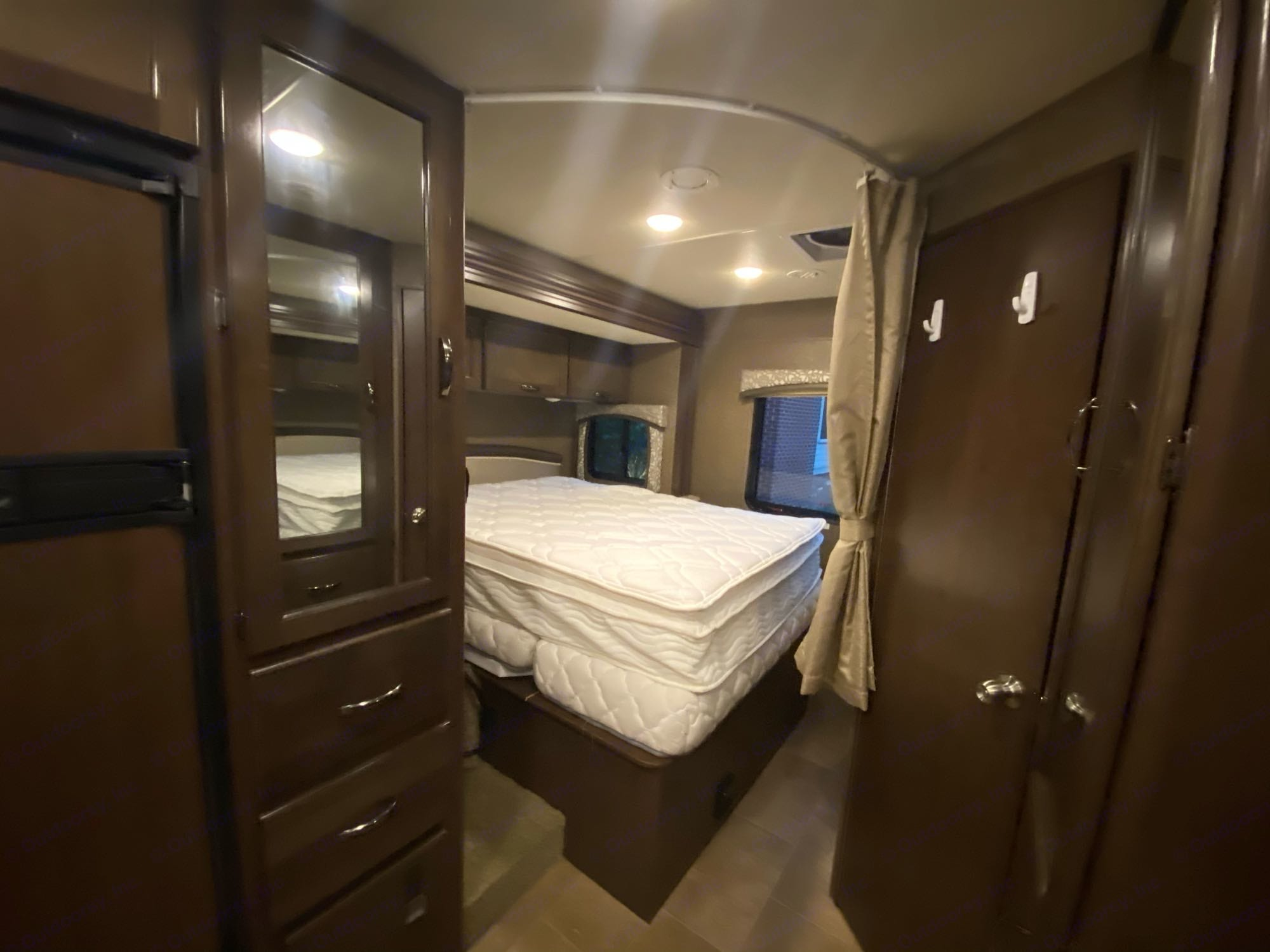 Back bedroom with queen sized bed. Privacy curtain shuts this area off from the rest of the RV. Flat screen TV is at the foot of the bed.. Thor Motor Coach Chateau 2018