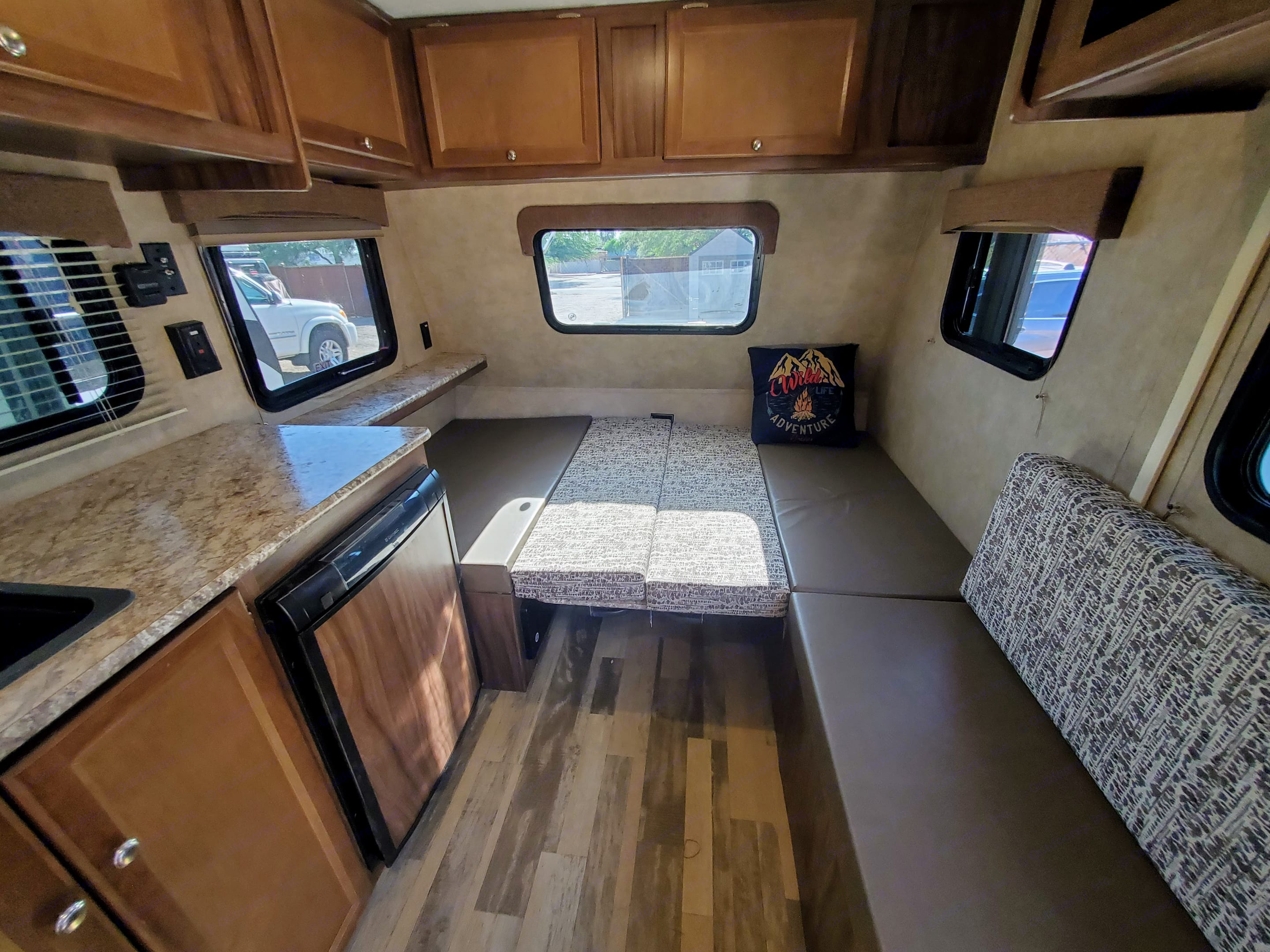The dinette collapses into a queen-sized mattress.. Coachmen Viking 14R 2018