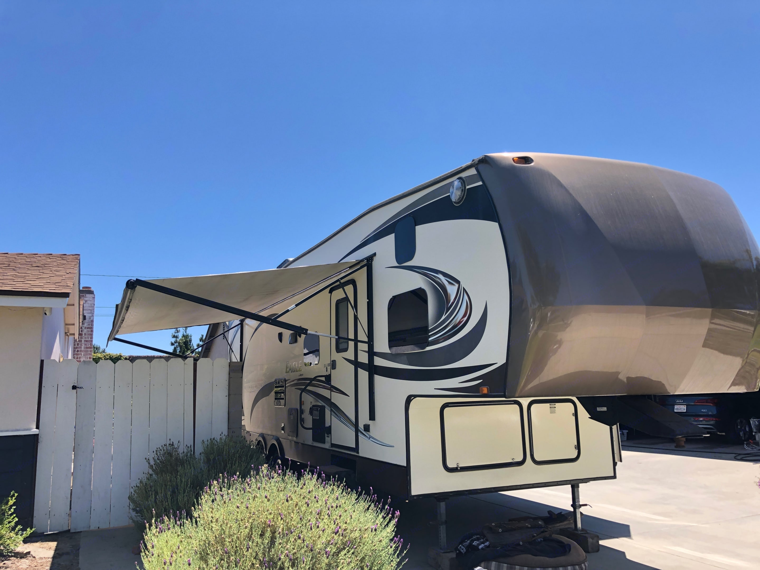 Entry Side with large awning, outdoor speakers and lights. Jayco Eagle 2015