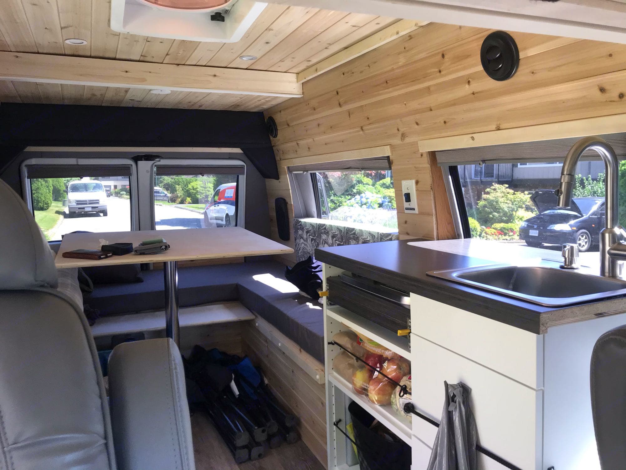 Cozy wrap around bench seating, kitchenette with pull out 2 burner cook top. Dodge B Van 2002