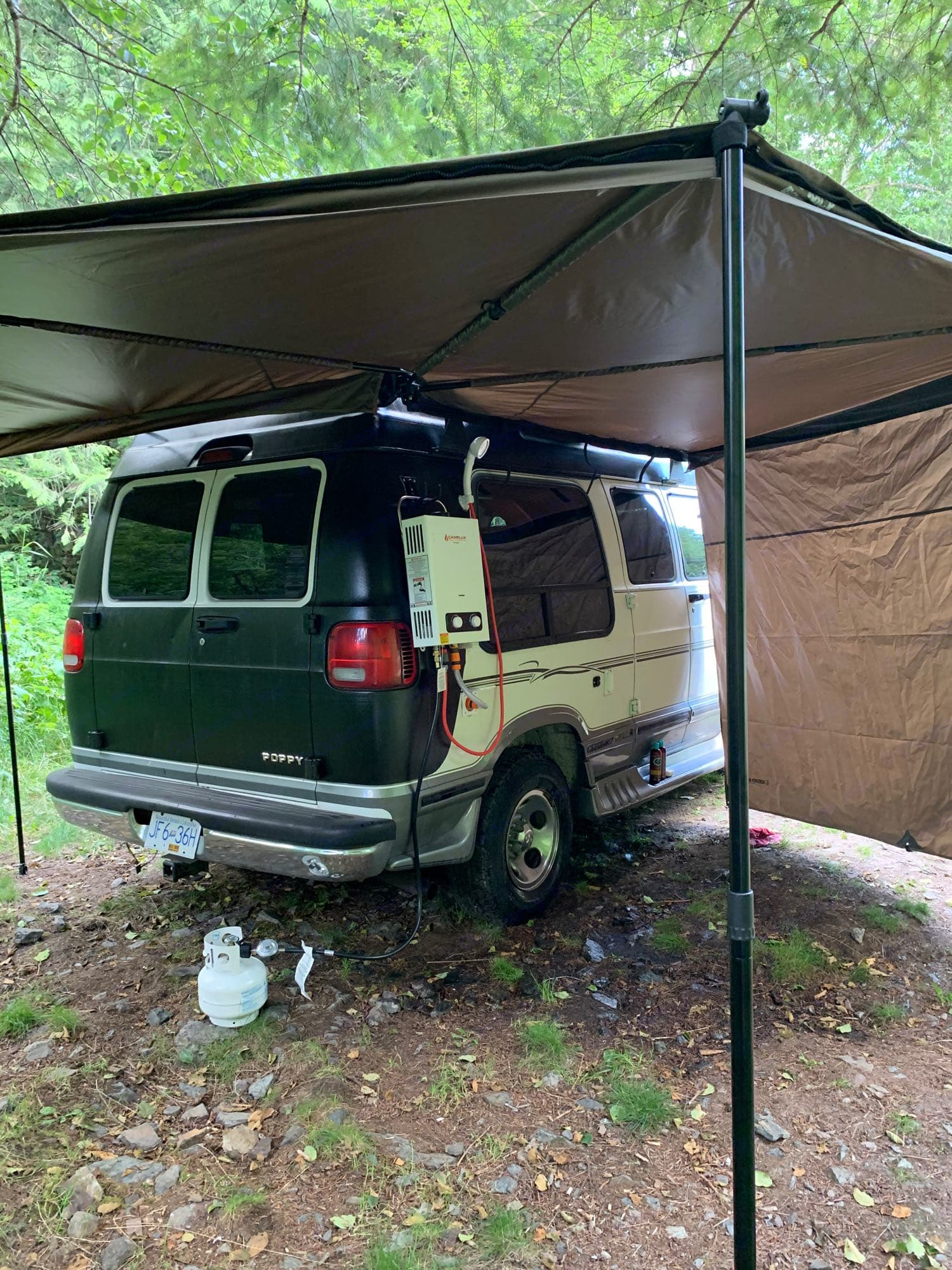 The batwing awning and outdoor hot water shower are epic!. Dodge B Van 2002