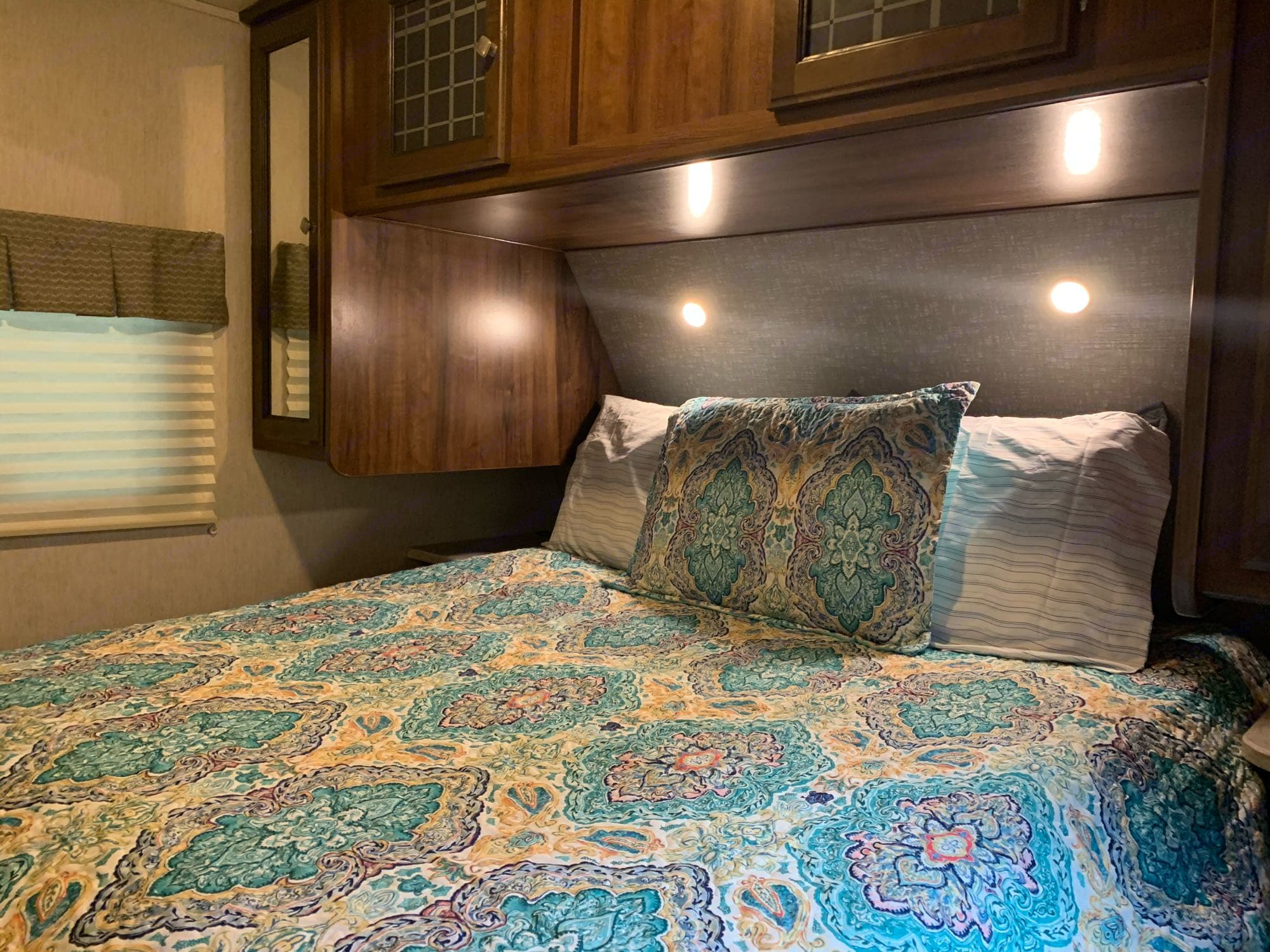The front, master bedroom has a comfy queen bed and plenty of storage for your clothes... plugs on both side of the bed.. and nightstands.. Heartland Other 2018