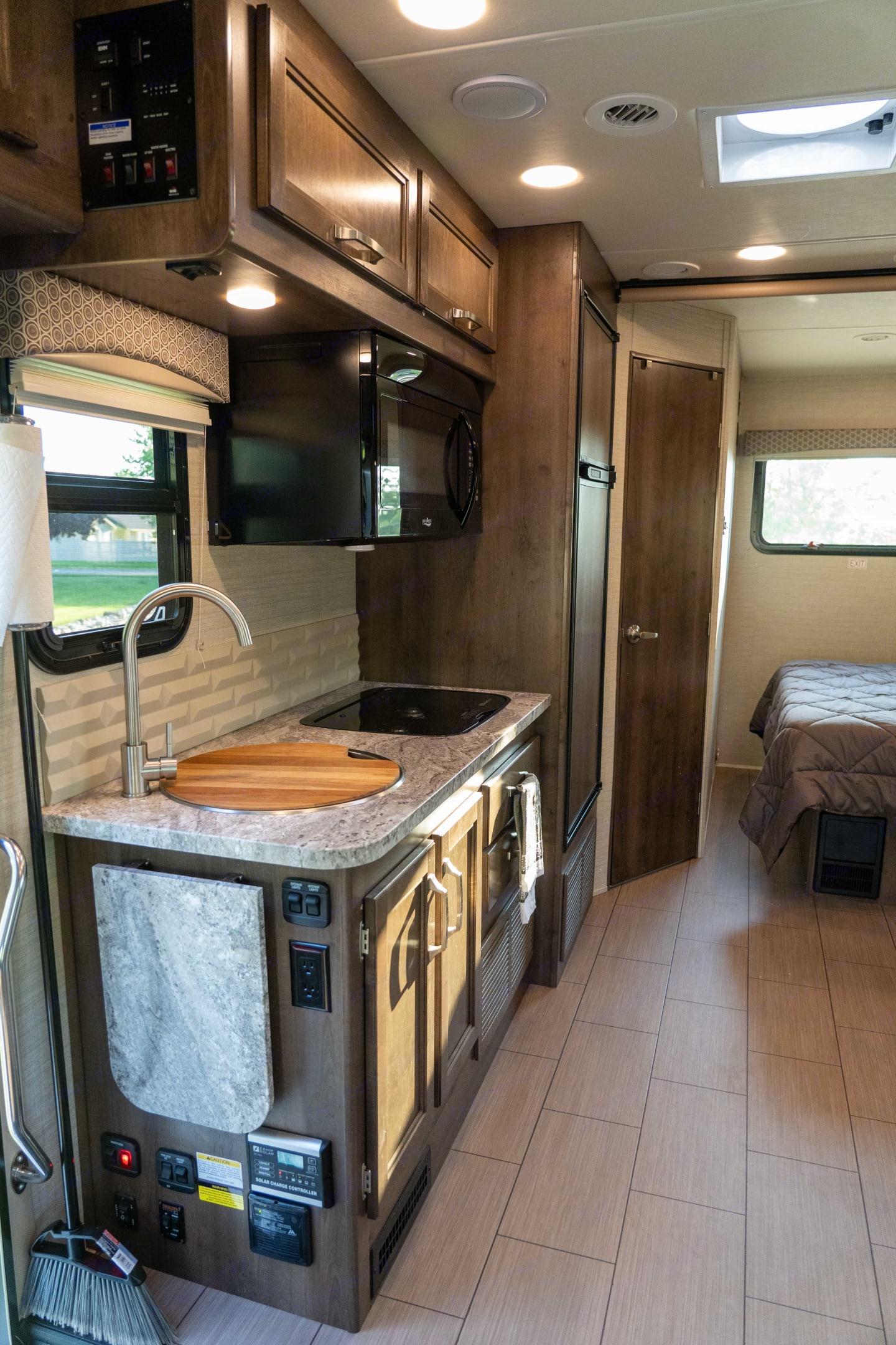 Kitchen area (passenger side). Jayco Melbourne 2019