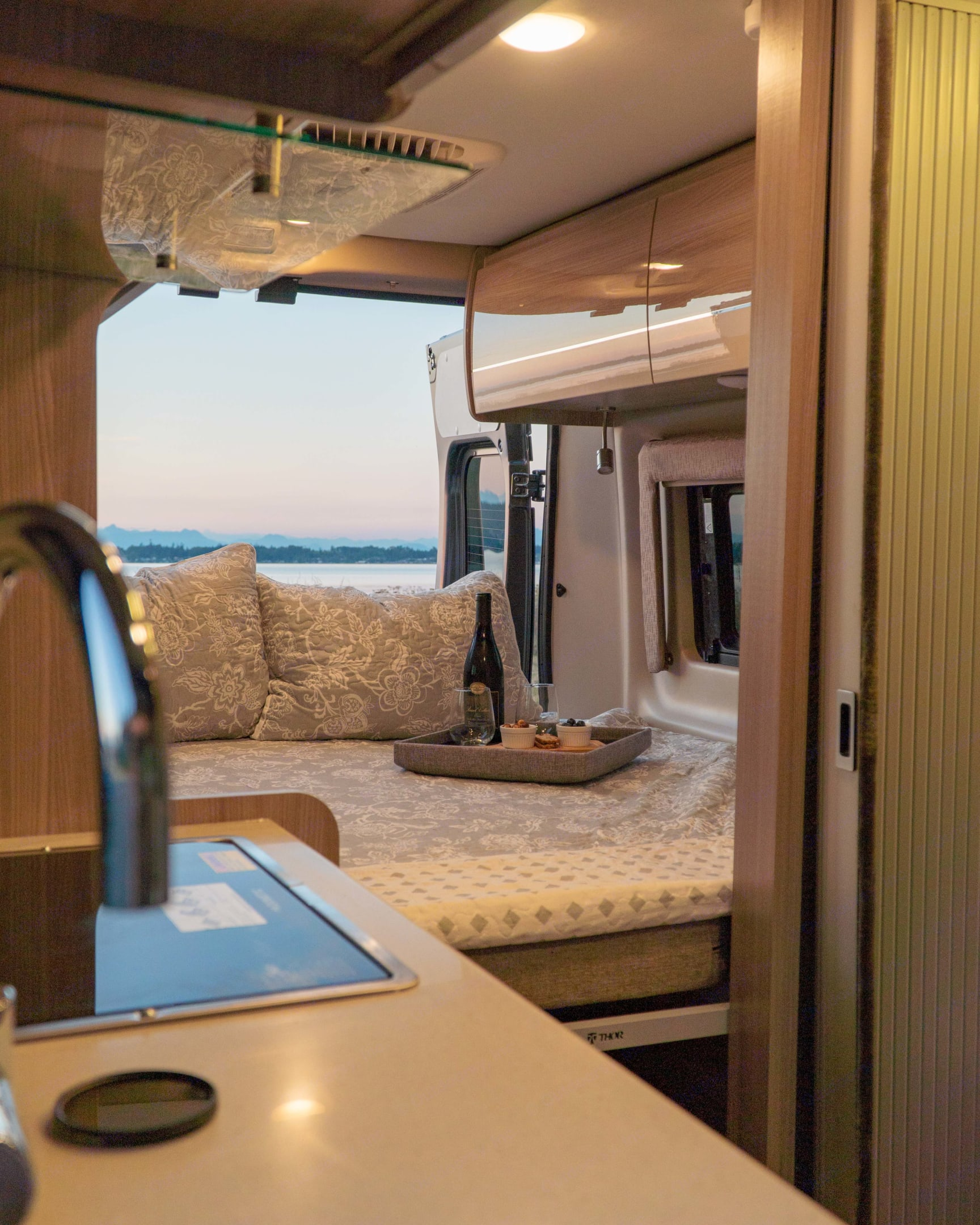 Bedroom set up as a king bed. Thor Motor Coach Sequence 2021
