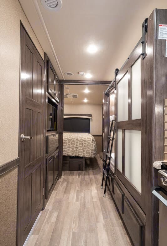 View of bathroom, bunks, and master bedroom. Fleetwood Flair 2020