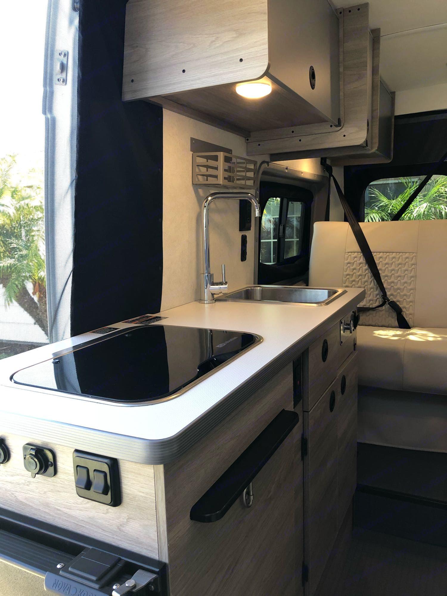 Kitchen Area (2 burner stove, refrigerator, sink, spice rack, cutting board and storage). Winnebago Other 2021