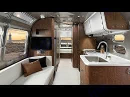 Nice cream layout dining/living area. Airstream Globetrotter 2020