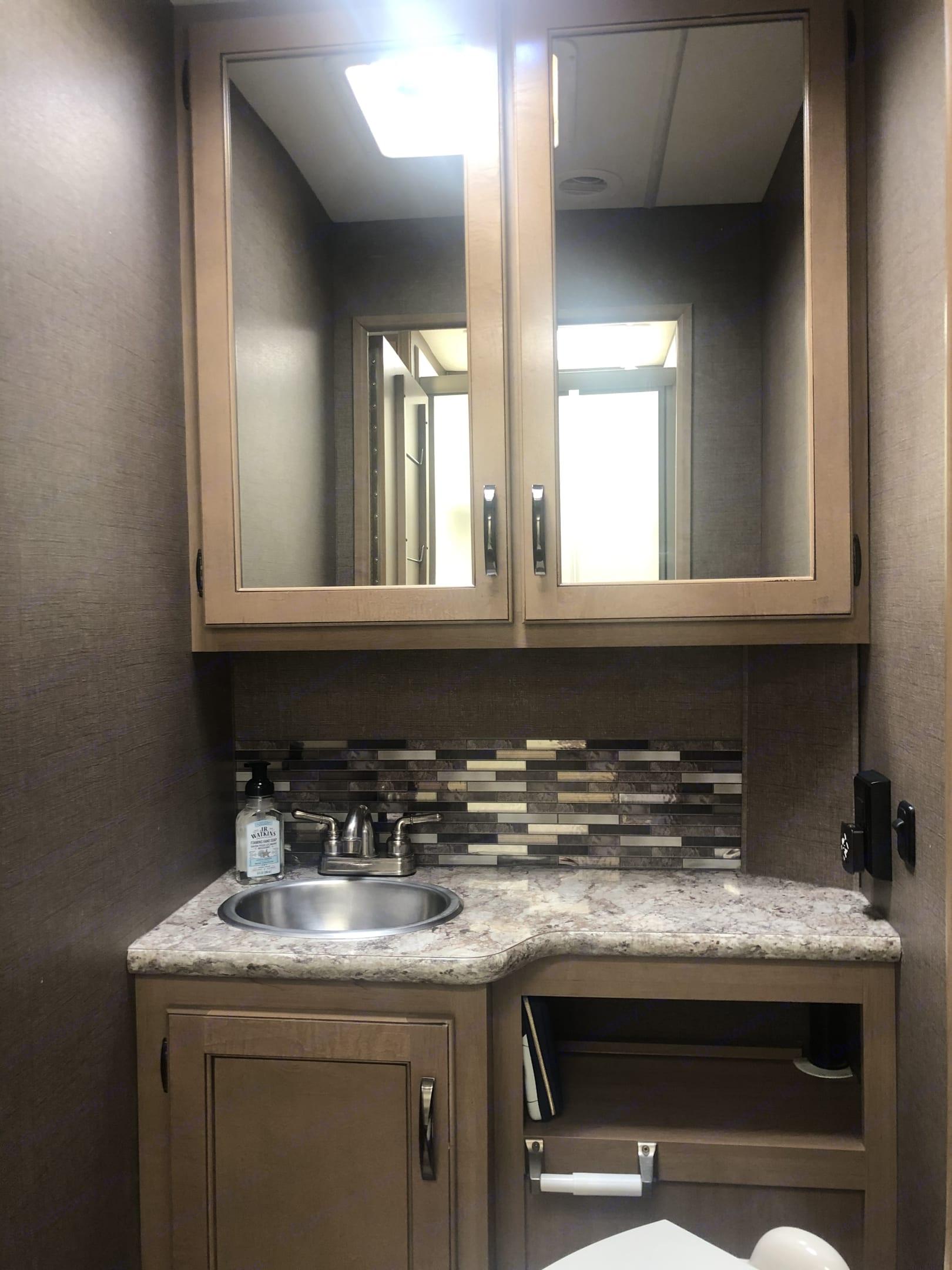 Spacious bathroom with plenty of storage. Thor Motor Coach Four Winds 2019