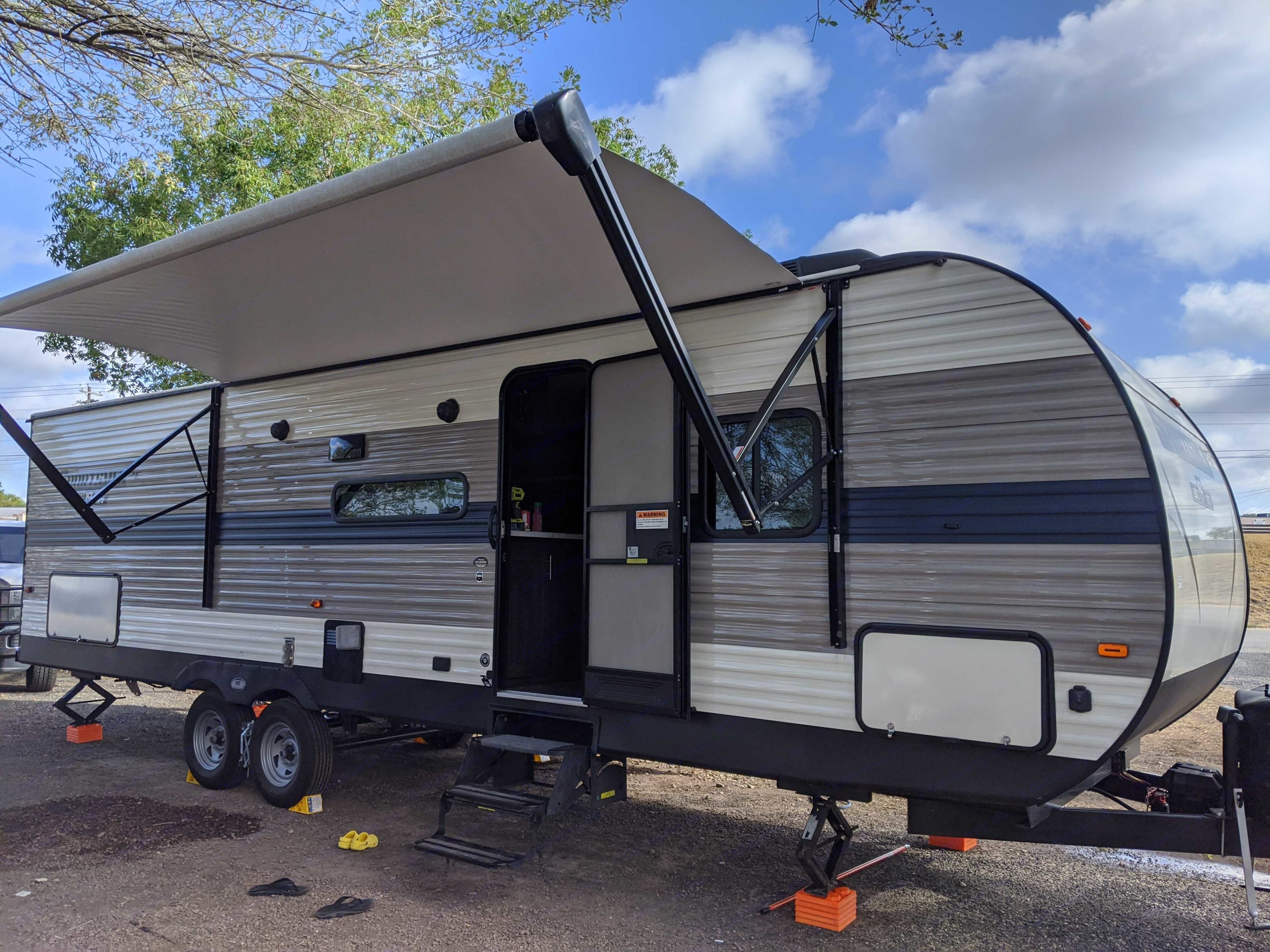 Door with awning up . K-Z Manufacturing Sportsmen 2020
