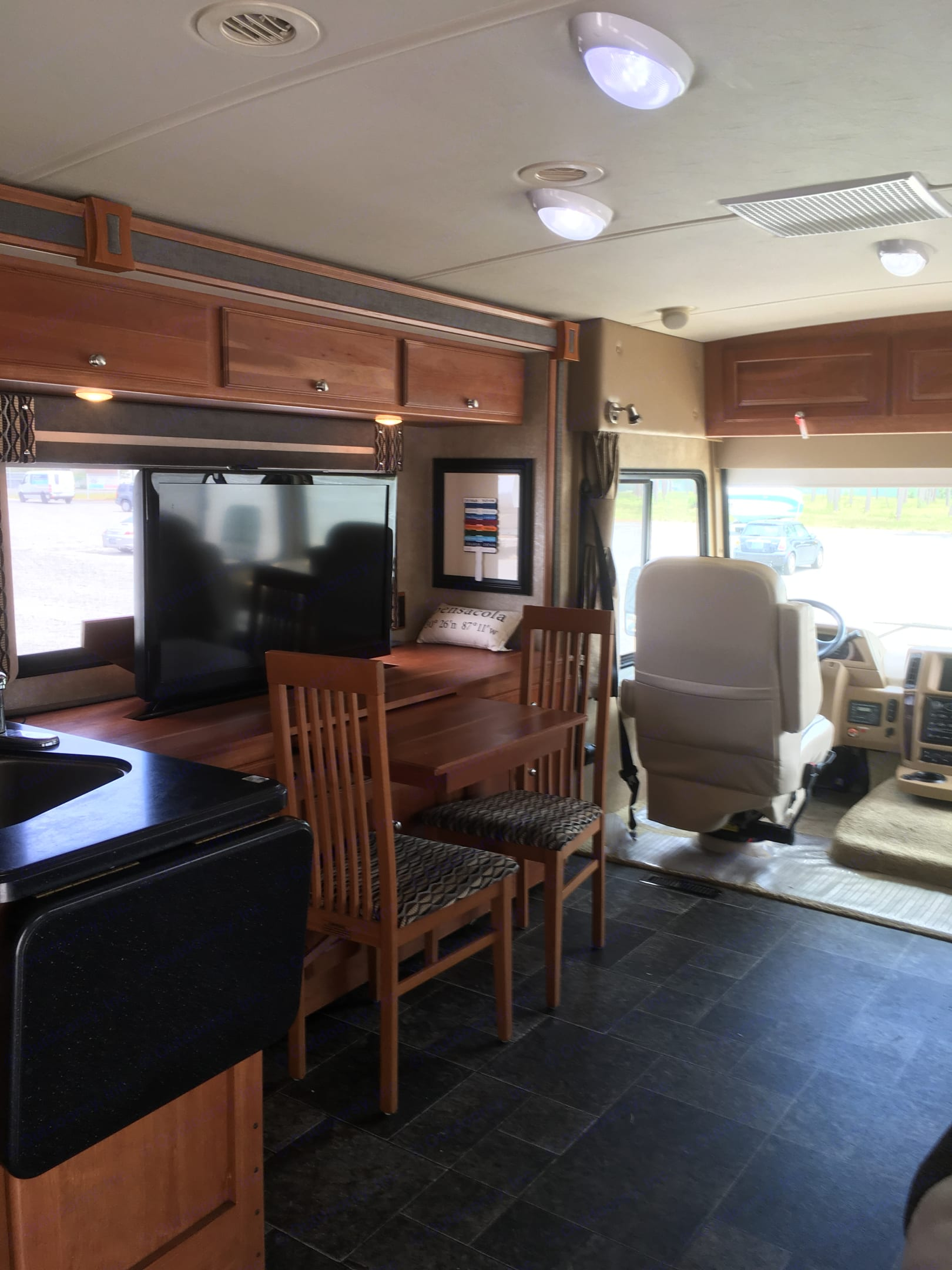 Dining room table.  Extra leaf and chairs seats 4. Winnebago Itasca Sunova 2014