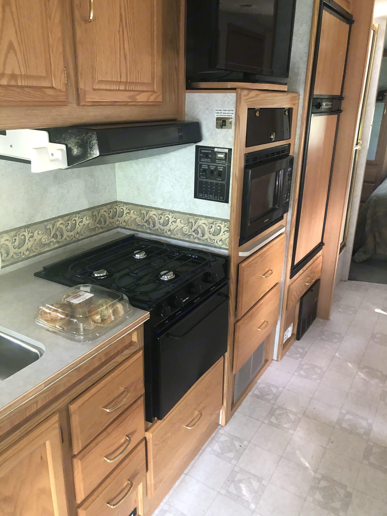 Kitchen with fridge stove micro. Winnebago Minnie Winnie 2002