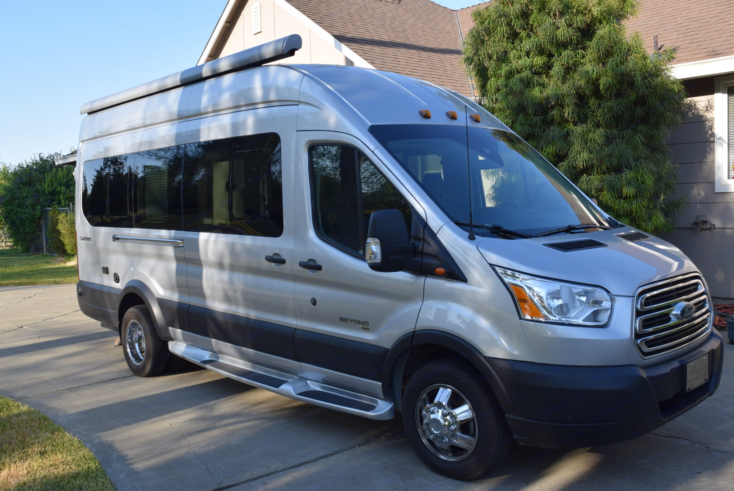 Passenger side.  Note sliding door and electric awning that extends out from roof.. Coachmen Beyond 2020