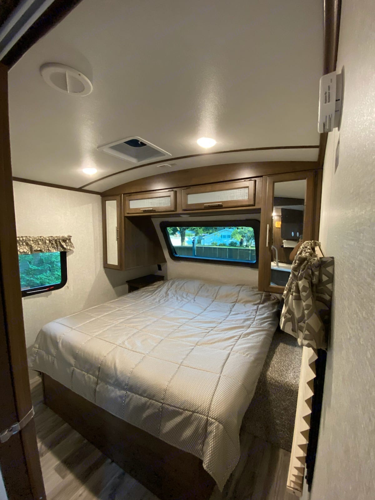 Bedroom with King sized mattress and tons of hanger and cabinet storage. Keystone Cougar Half-Ton 2019