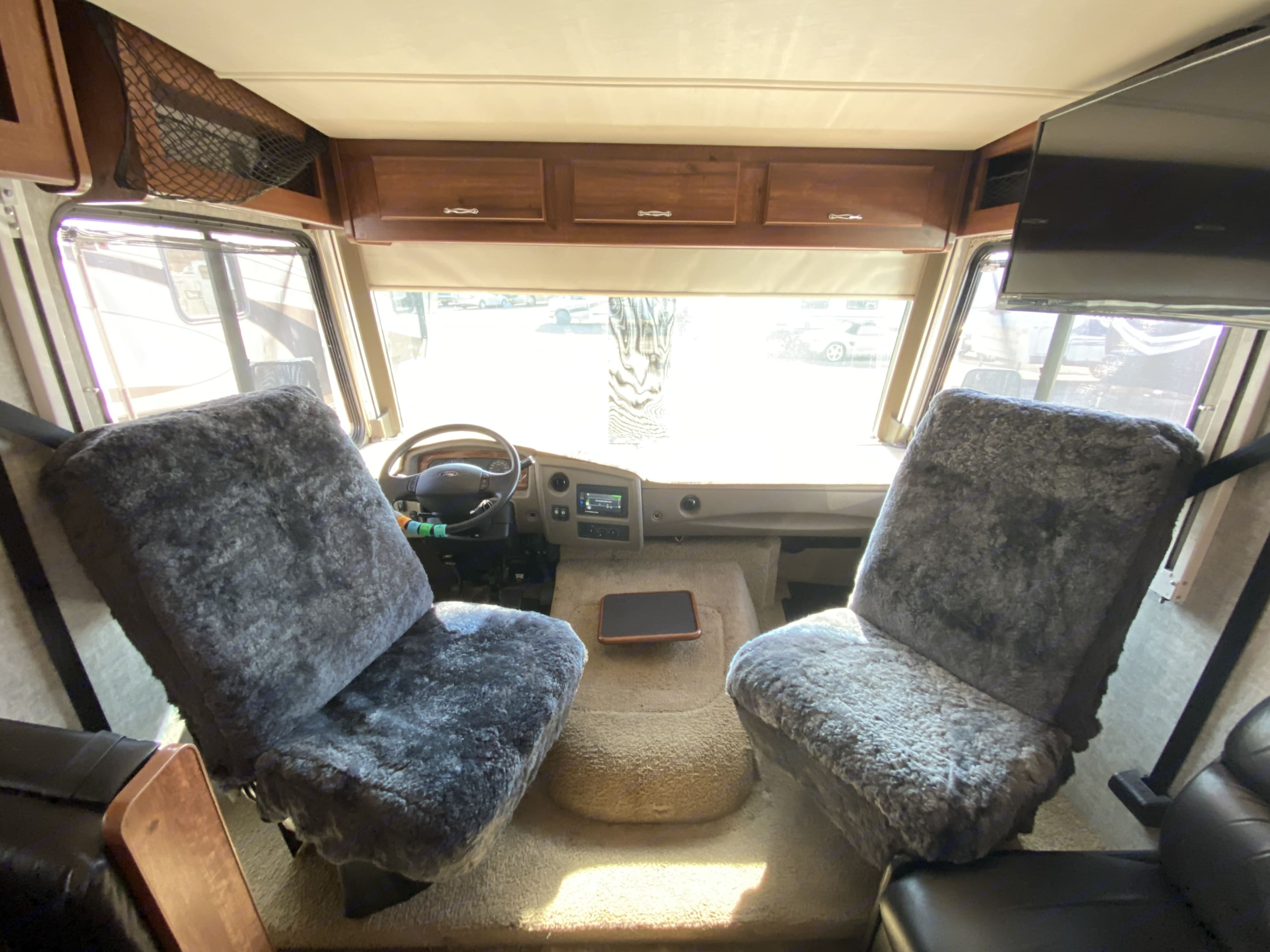 Captain chairs with brand new covers that add comfort to your long drives.. Fleetwood Storm 2014