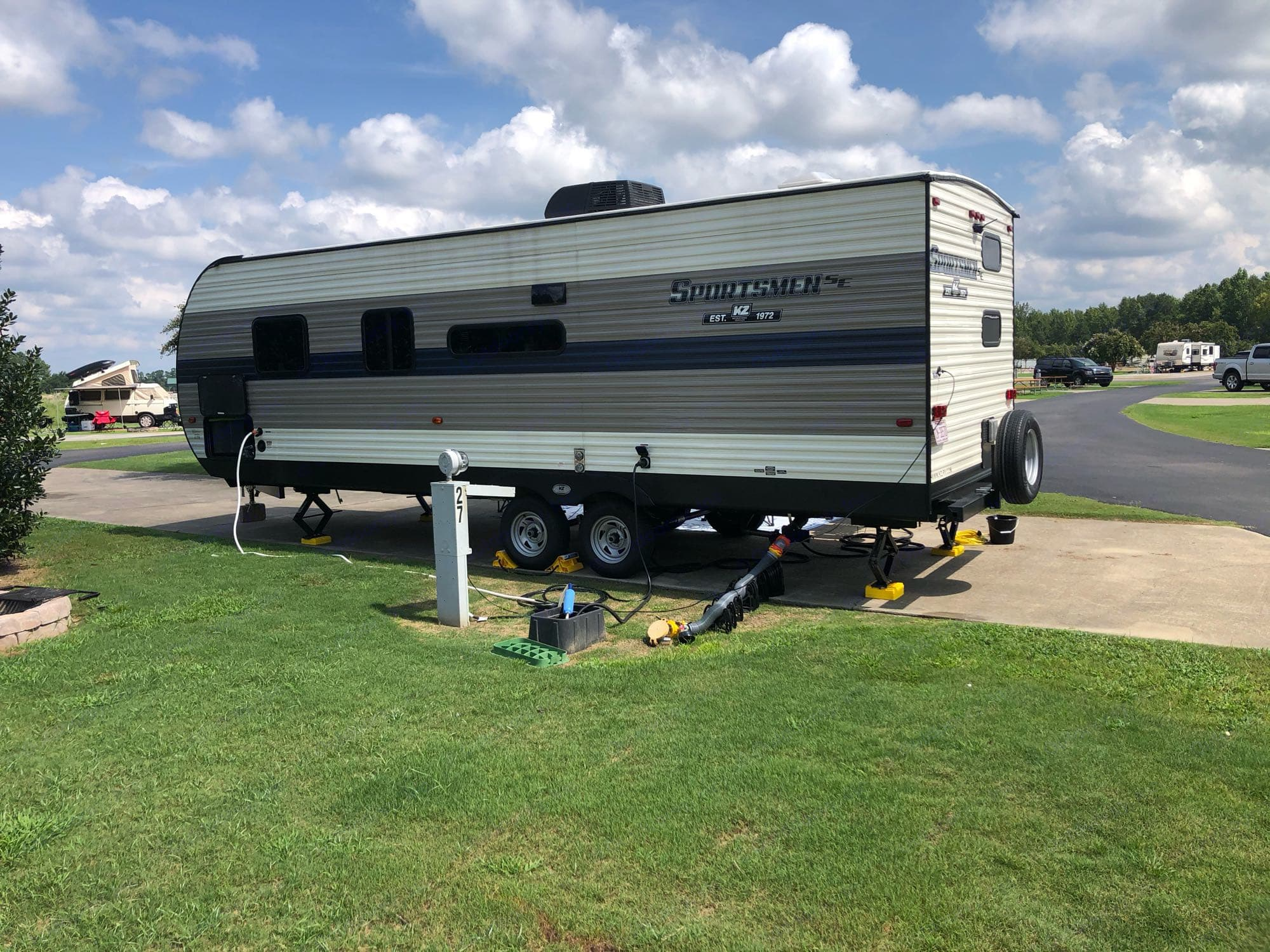 """""""Driver"""" side of the travel trailer--where the hook ups are.. K-Z Manufacturing Sportsmen 260 BHSE 2020"""