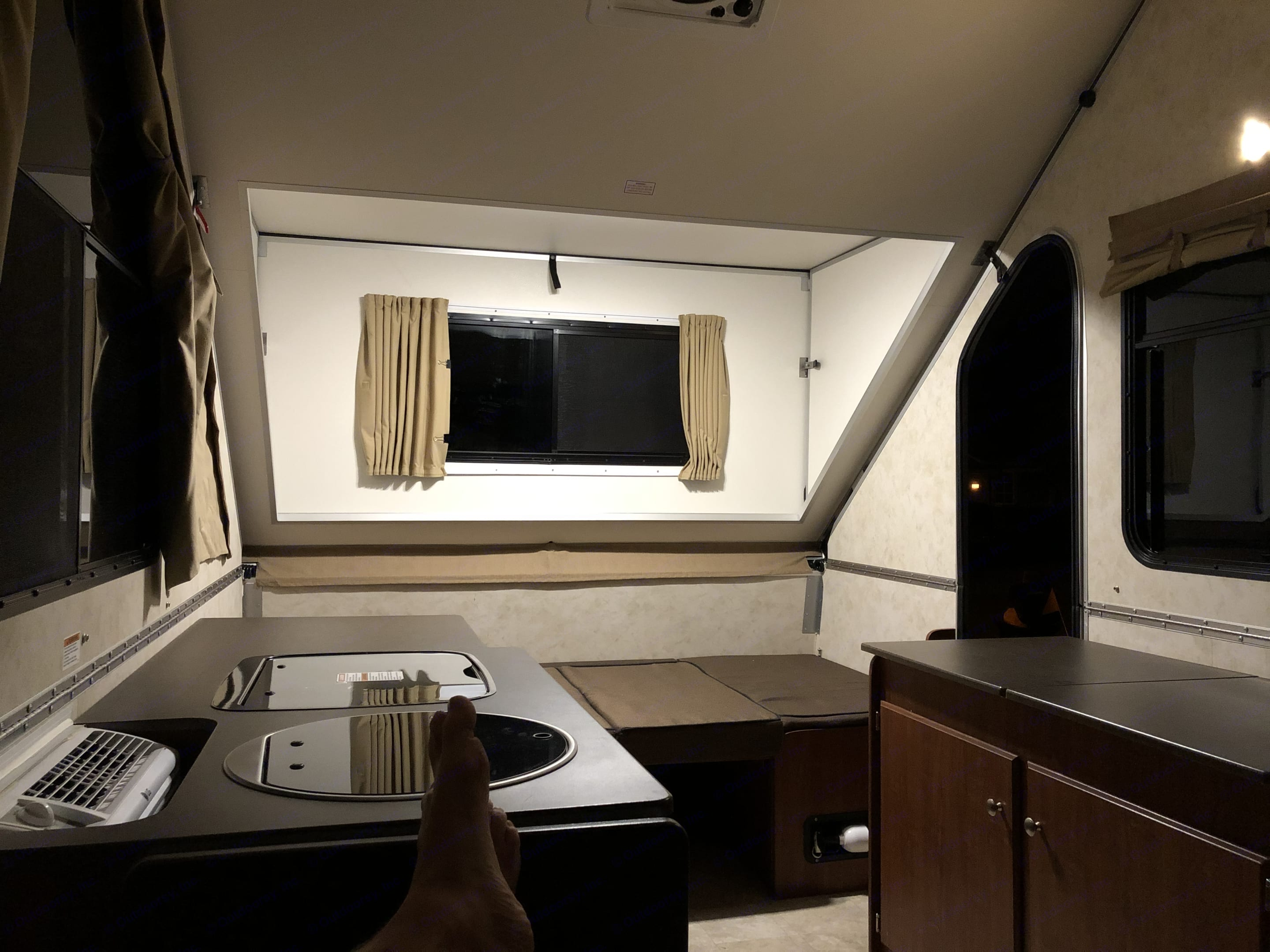 AC, sink, range to the left. Bed at other end converts to a table.. A-Liner Expedition 2017