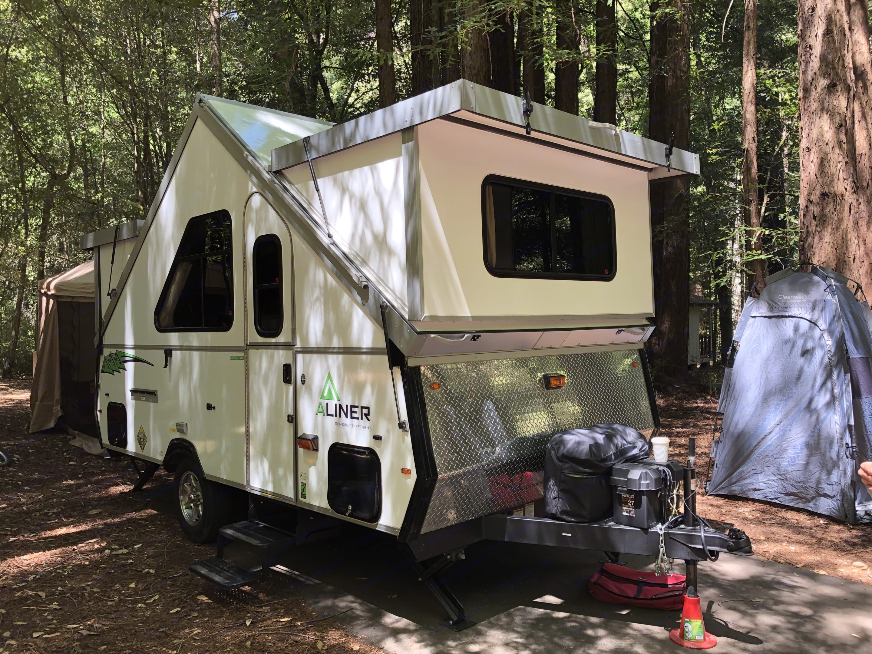 Dual propane tanks and a battery. Potty/shower tent in gray.. A-Liner Expedition 2017