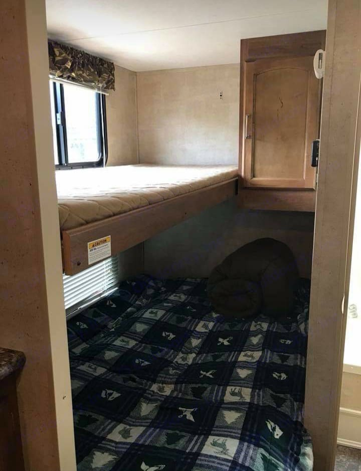 Rear Bed and Bunk (top bunk folds up to accommodate additional headroom for bed below). Keystone Springdale 2015