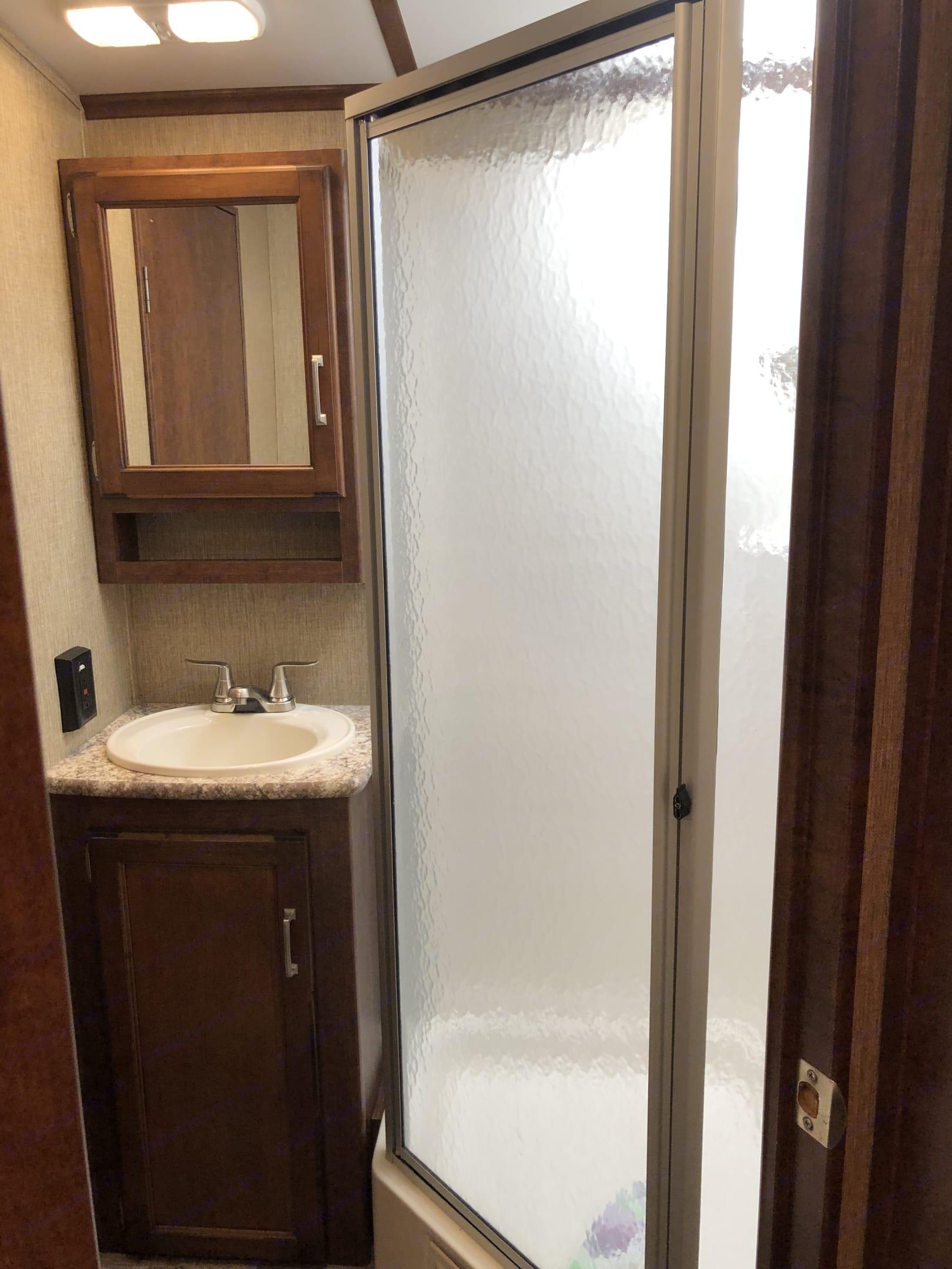 Trailer has one bathroom with shower.. Keystone Outback 2017