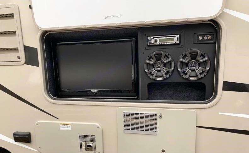 Outdoor Entertainment System - HD TV and stereo. TV works with HD antenna on the roof for local broadcasts and external streaming devices.. Coachmen Leprechaun 2014