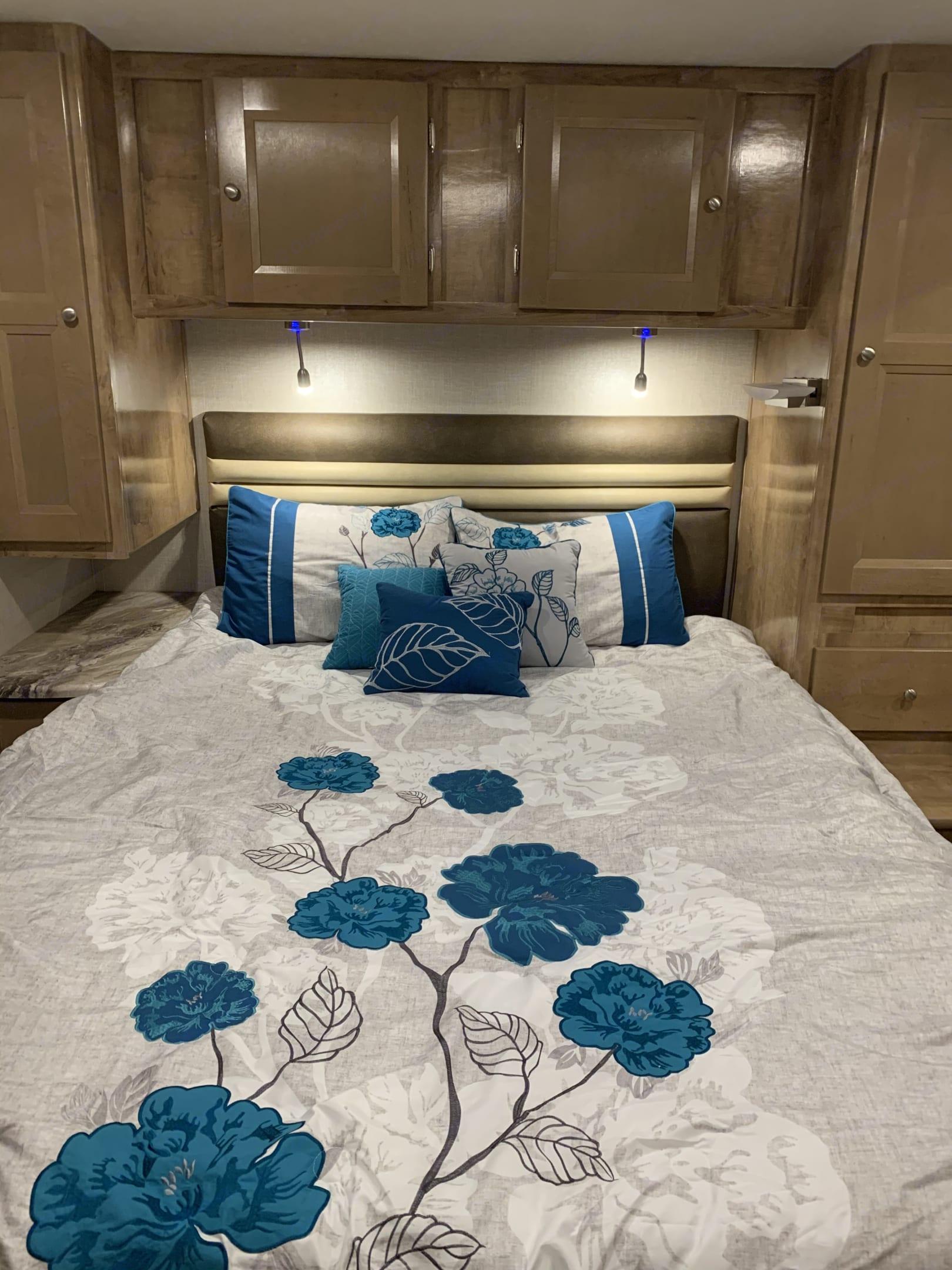 Serene bedroom with queen bed. Coachmen Leprechaun 2020
