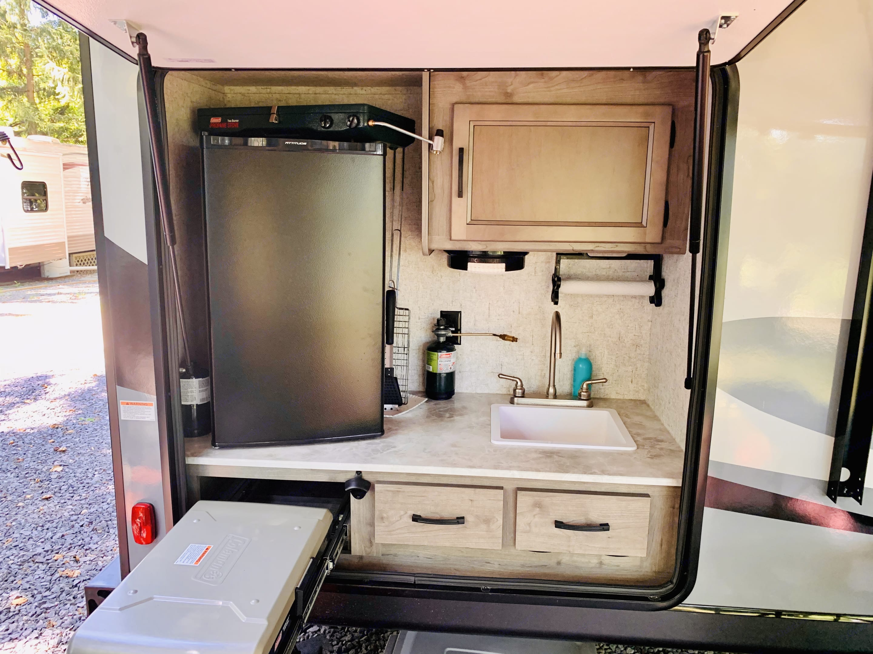 Outside Kitchen with fridge, sink, & pull-out grill. Coachmen Apex 2021