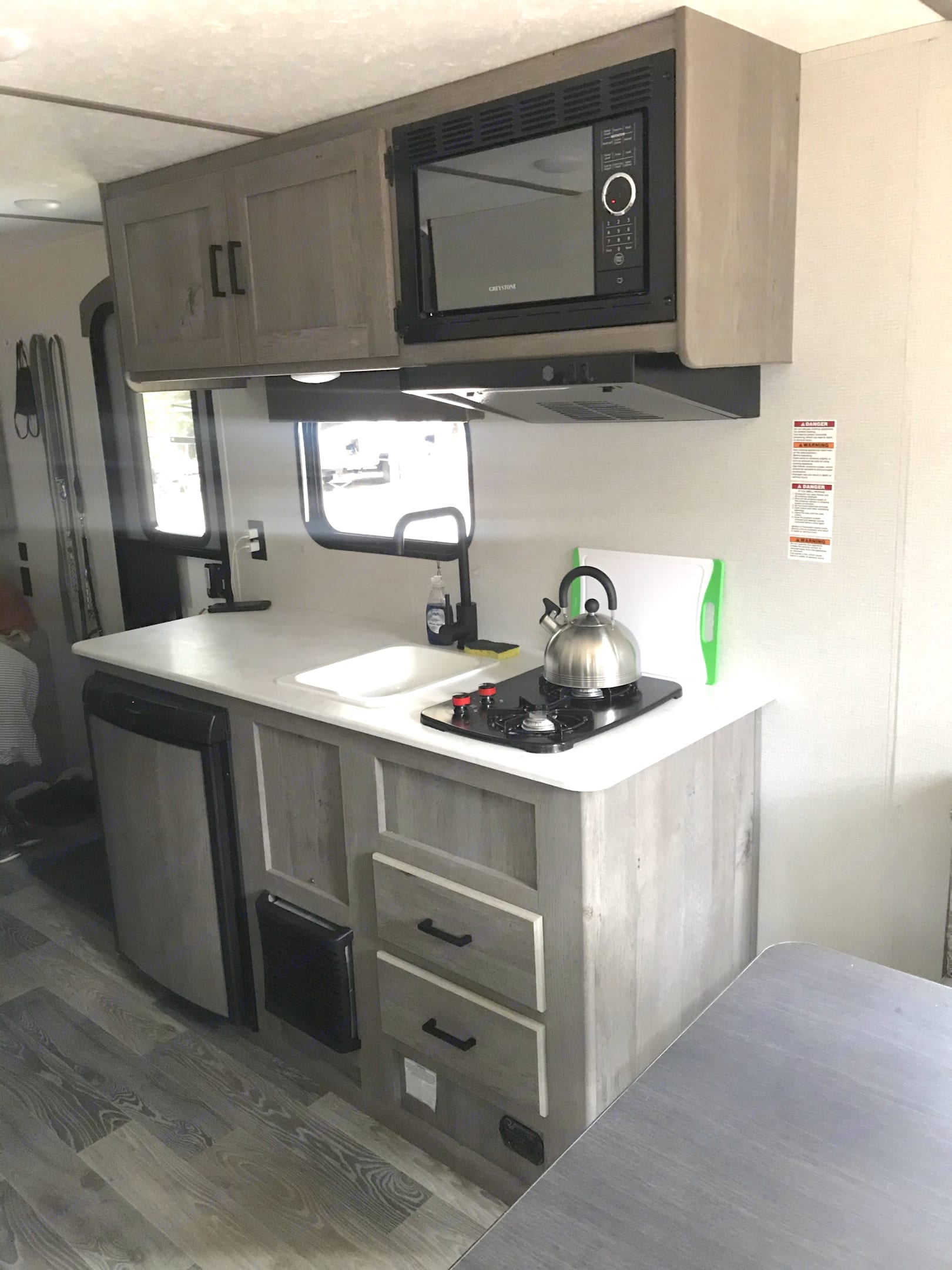 well equipped kitchen with a 2-burner gas range, microwave, and fridge.. Keystone Springdale 2021
