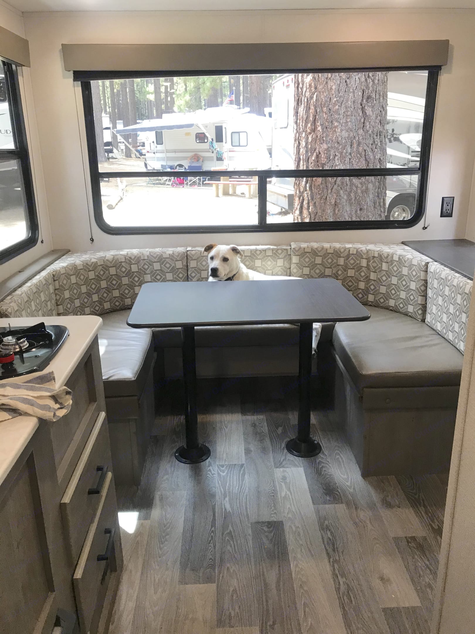 U-shaped dinette that transforms into a double bed. Storage under the benches. Keystone Springdale 2021