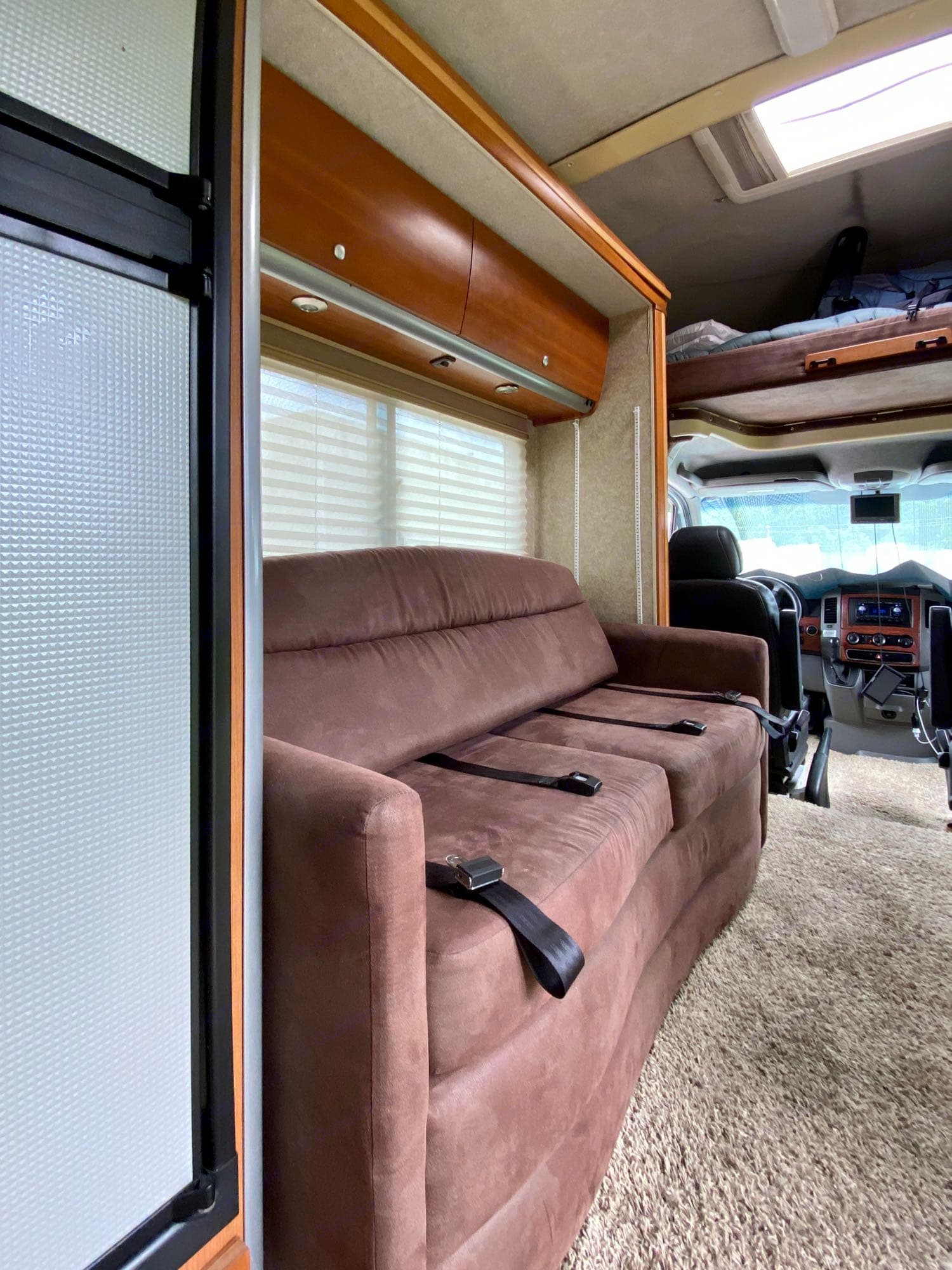 Couch with seat belts for passenger three and four. Slide retracted in drive mode.. Winnebago View 2009