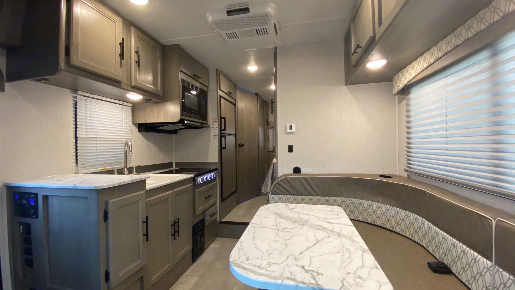 Salon looking back towards bedroom/bathroom. Coachmen Freelander 2021