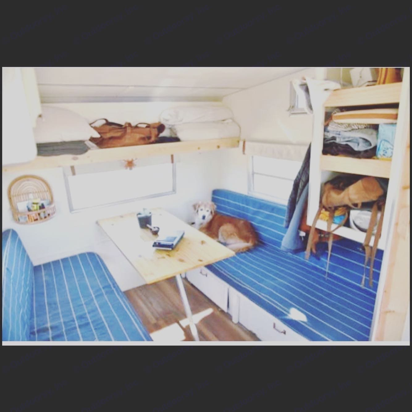 Seating area with refinished wood table. Converts to sleeping space.. Shasta Other 1971