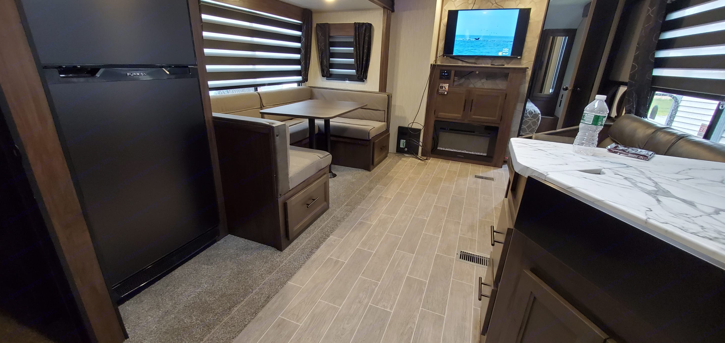 nice and roomy area to enjoy, fireplace has an ambience feature that is lovely to relax to.. Forest River Cherokee 2021