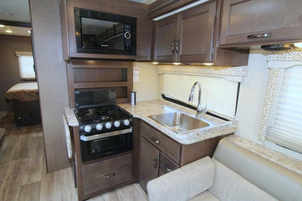 Microwave, oven, and range. Thor Motor Coach Freedom Elite 2020