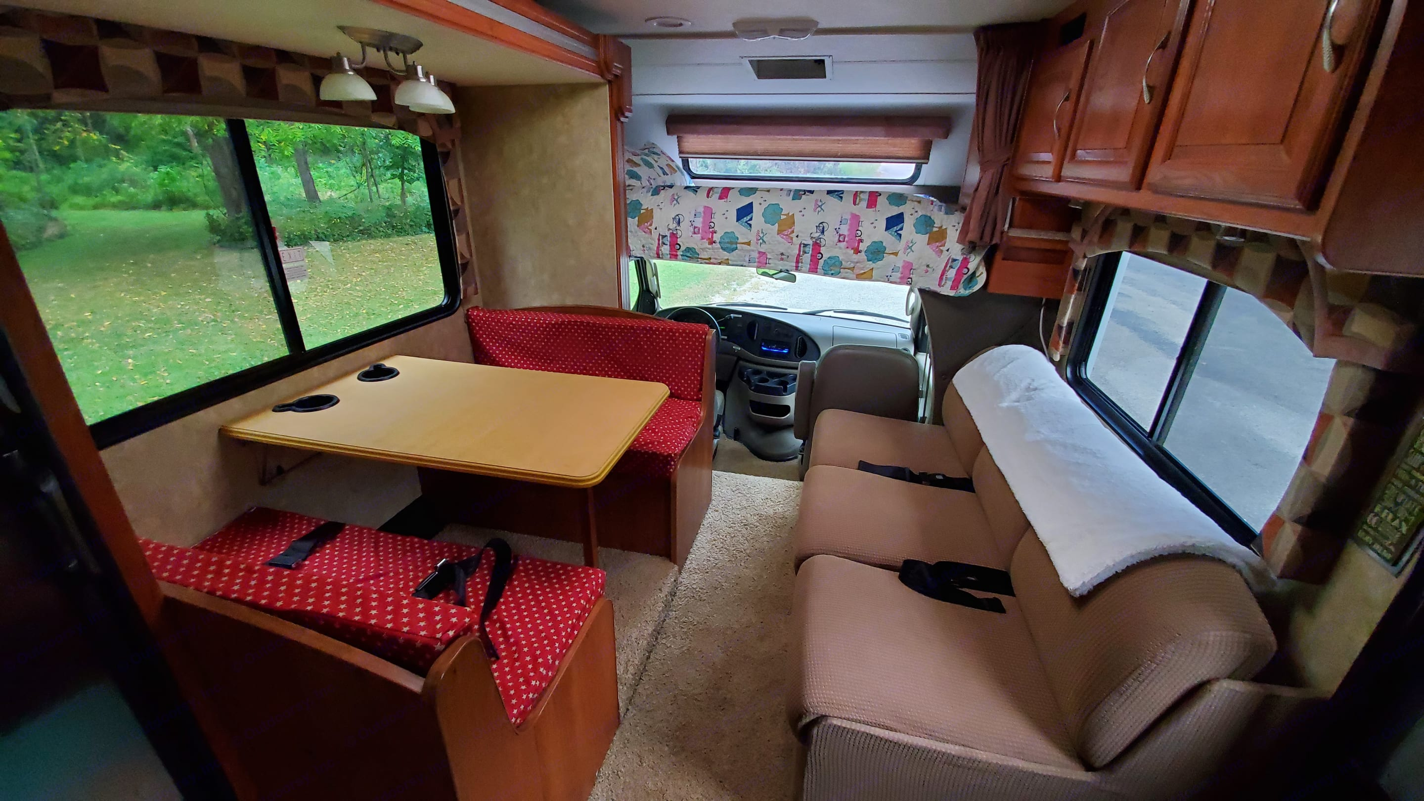 Living room with slide closed and blinds open. Coachmen Leprechaun 2008