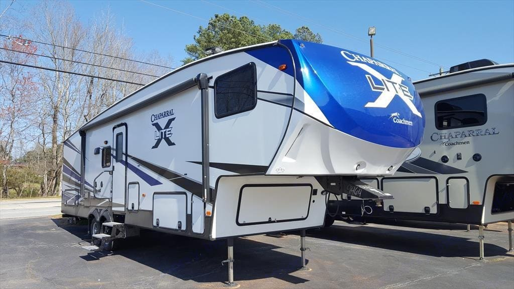 This is our exact camper before we took it off the lot.. Coachmen Chaparral 2018