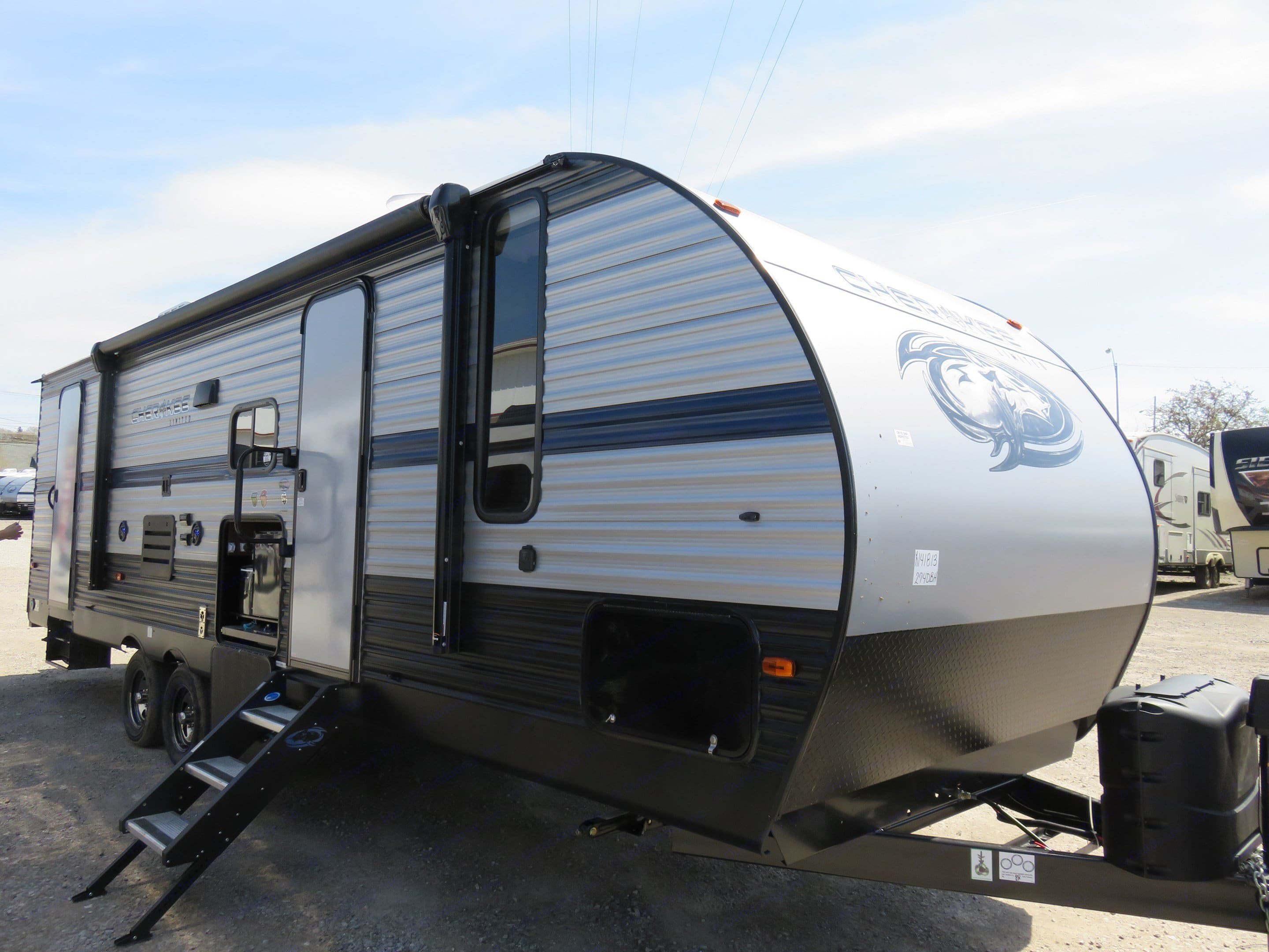 Hug awning and outdoor speakers. Forest River Cherokee Grey Wolf 2019