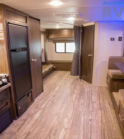 View back to bunk room, pantry (left) and bath (right). Forest River Cherokee Grey Wolf 2019