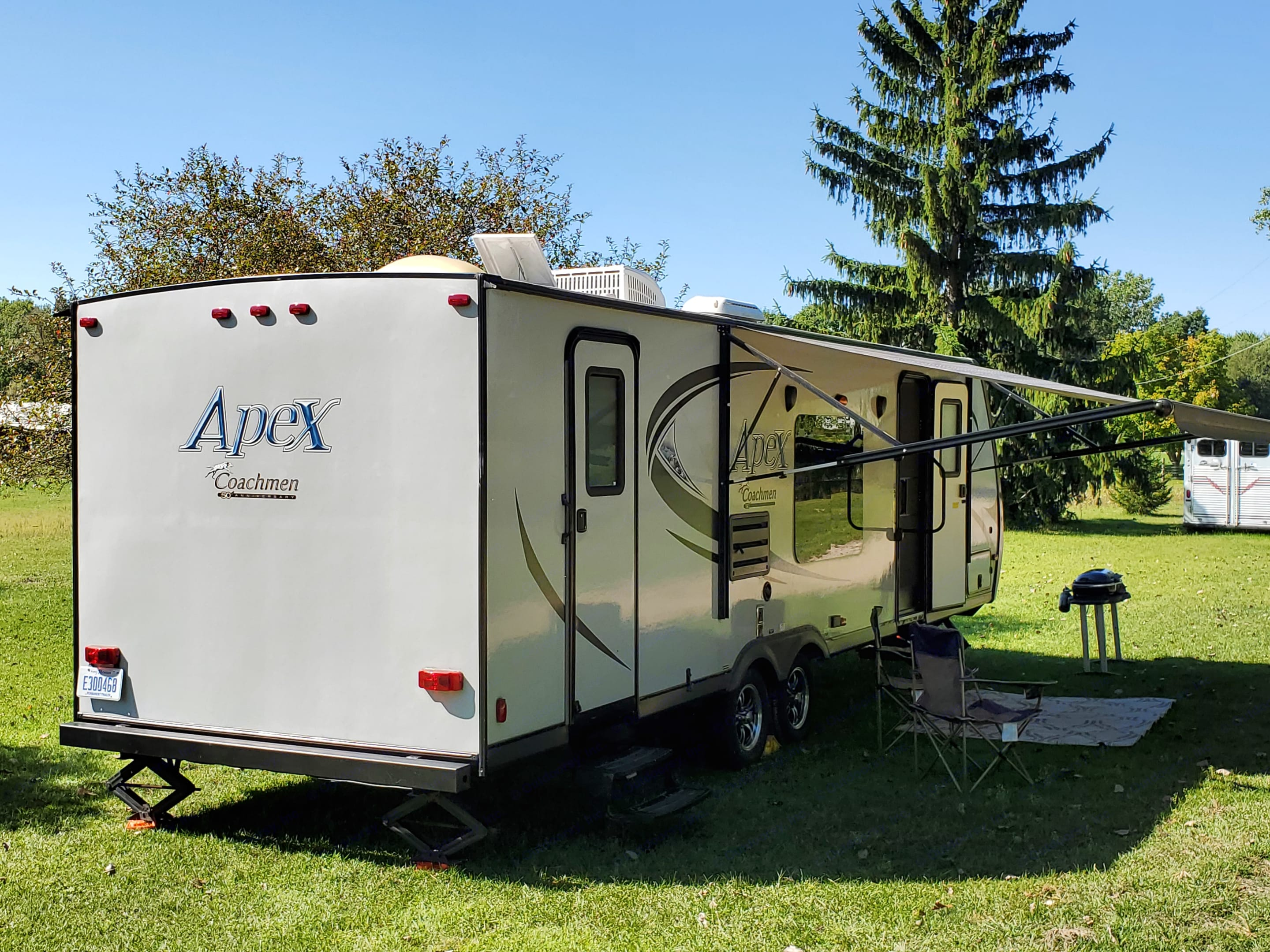 Rear Bumper holds two connectable ten feet Black water hoses. Remote button awning.. Coachmen Apex 2015