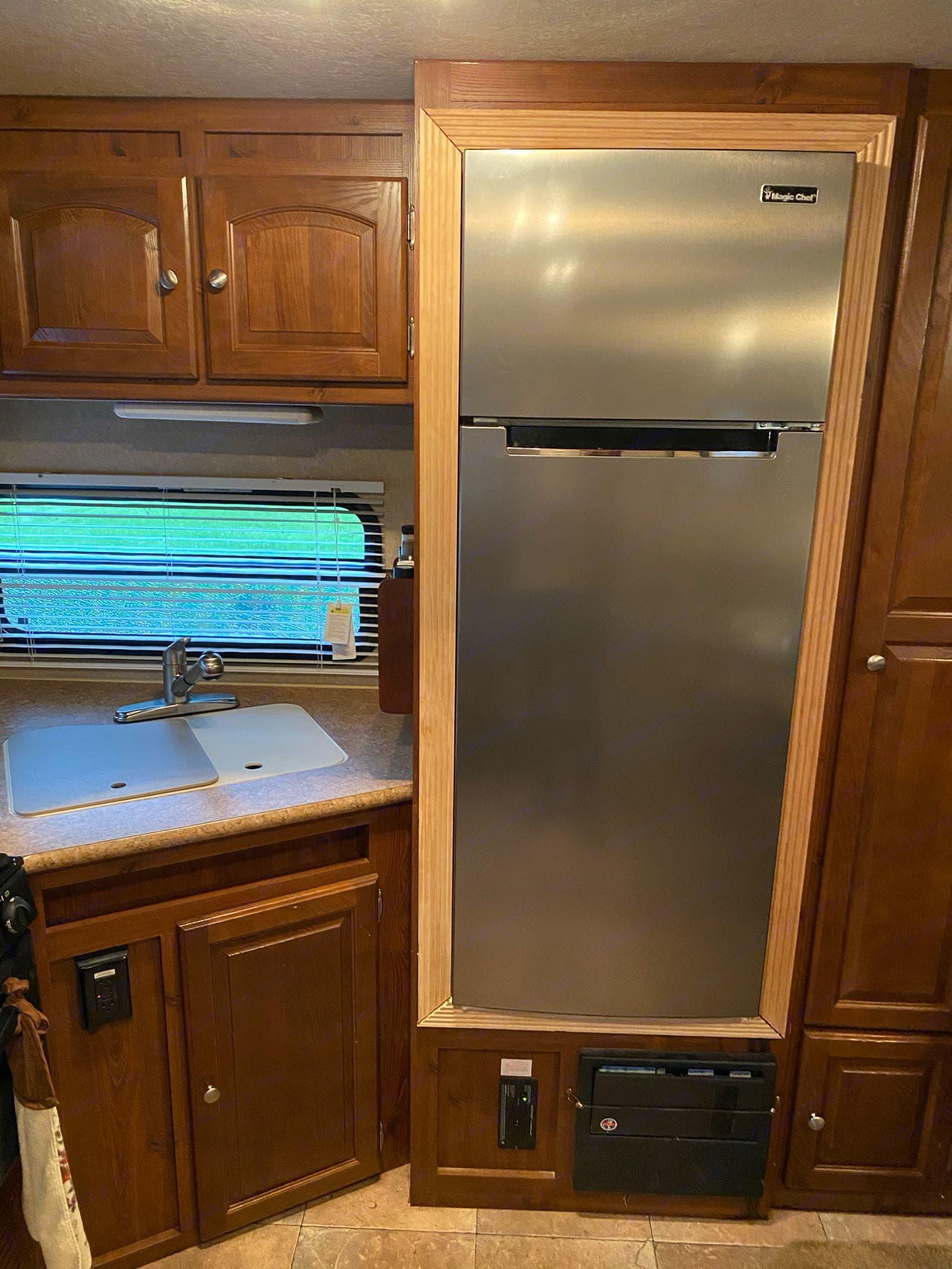 New residential refrigerator. Forest River Rockwood Windjammer 2012