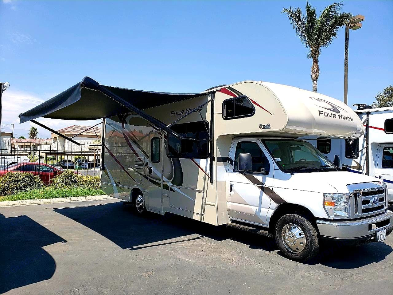 Awning has lights on the outside as well for nighttime. Thor Motor Coach Four Winds 2020