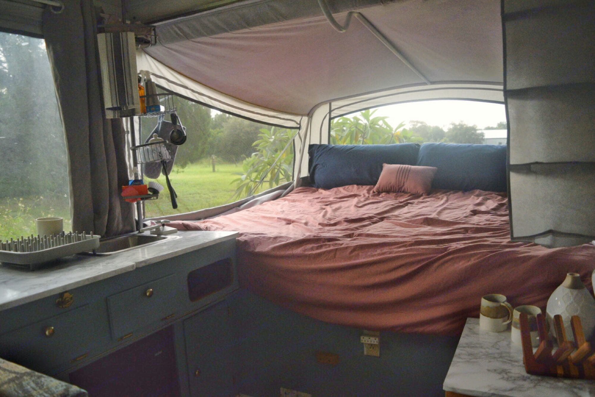 King size bunk, Galley with Mini Fridge and Sink. Propane stove is outside with this setup but can be brought inside and placed to the left of the sink.. Fleetwood Sedona 2001