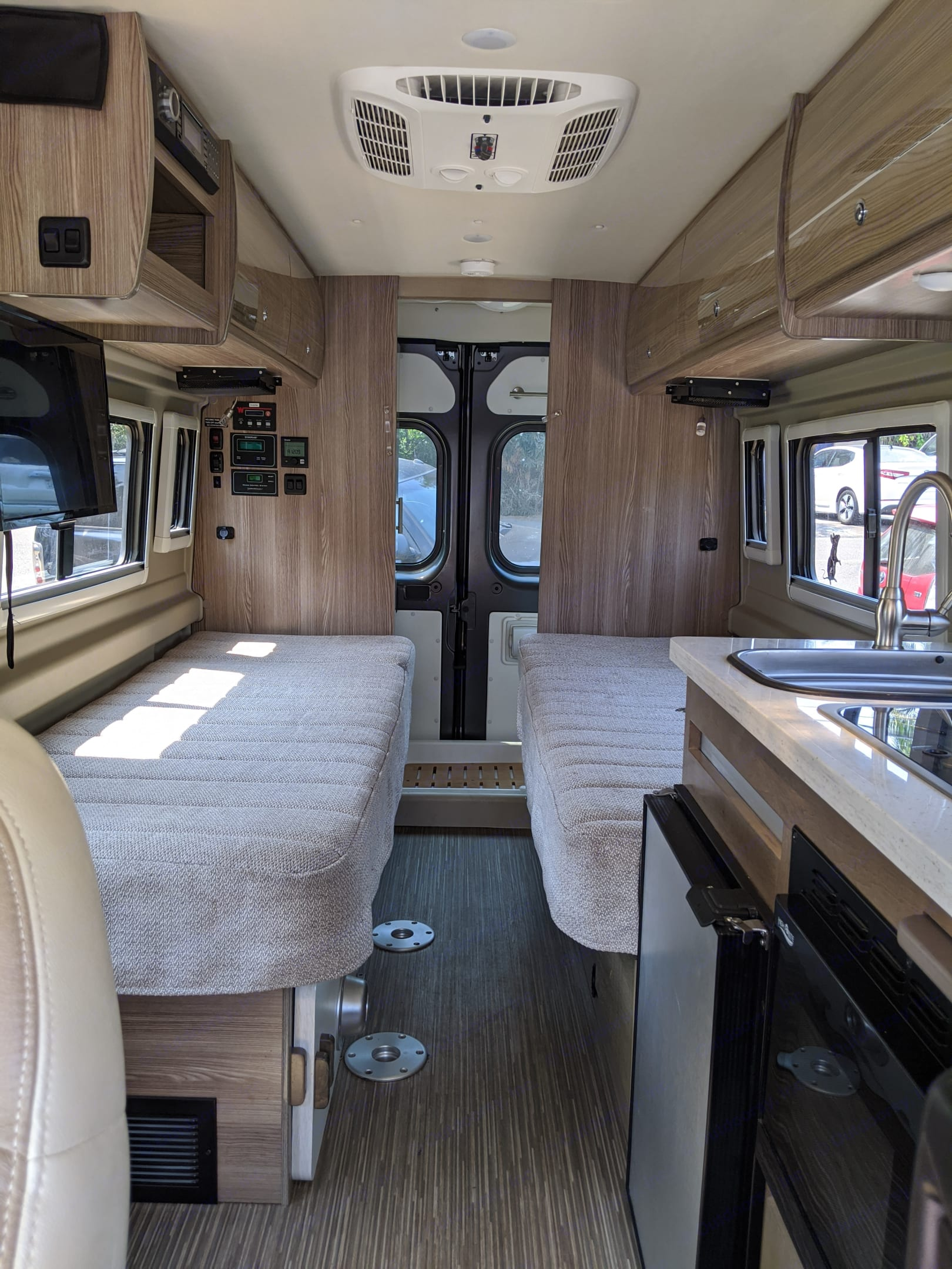 The main space - beds and table.  See two next photos. Winnebago Travato 2019