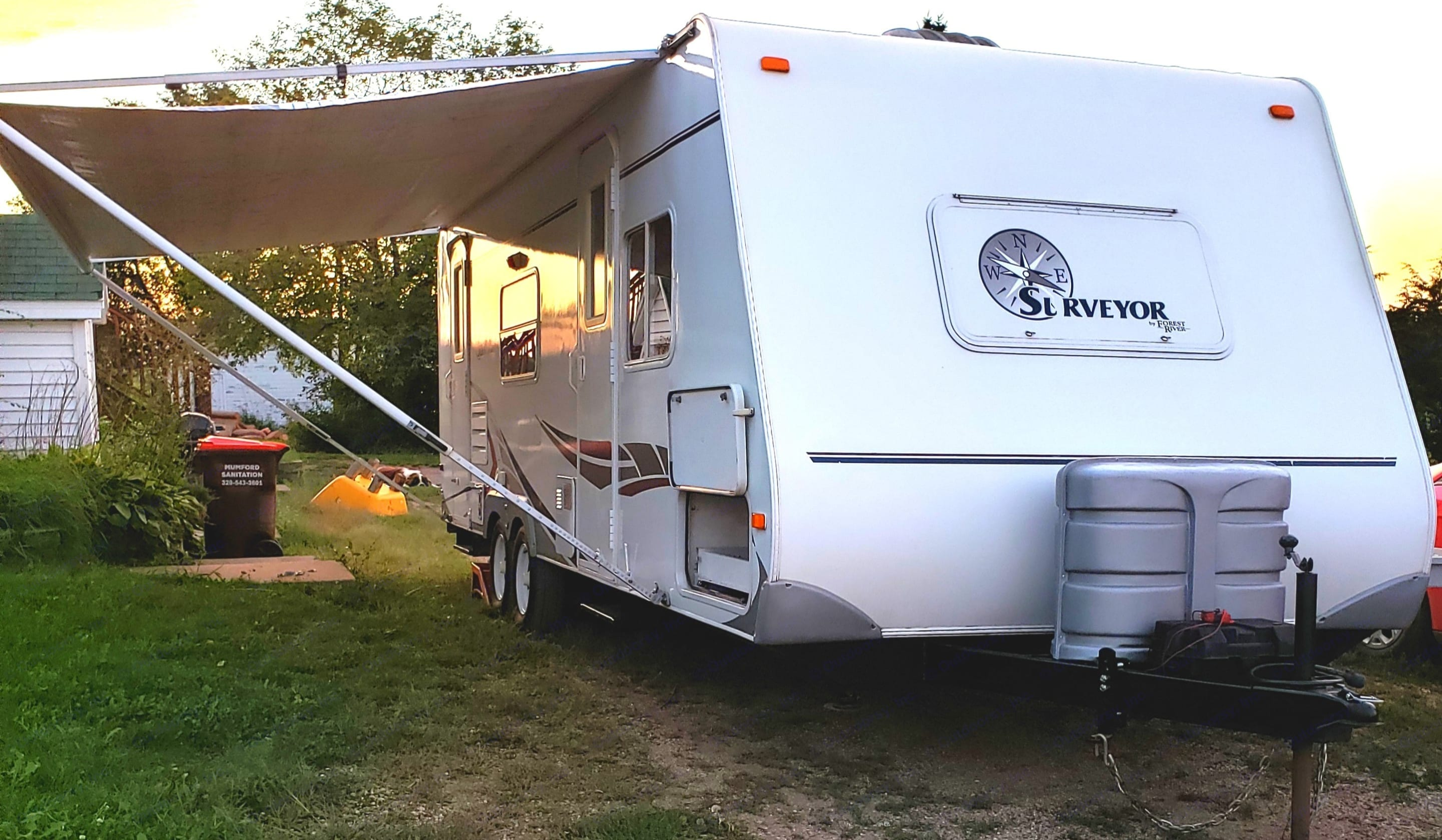 Exterior Front/Side w/Awning open. Forest River Surveyor 2006