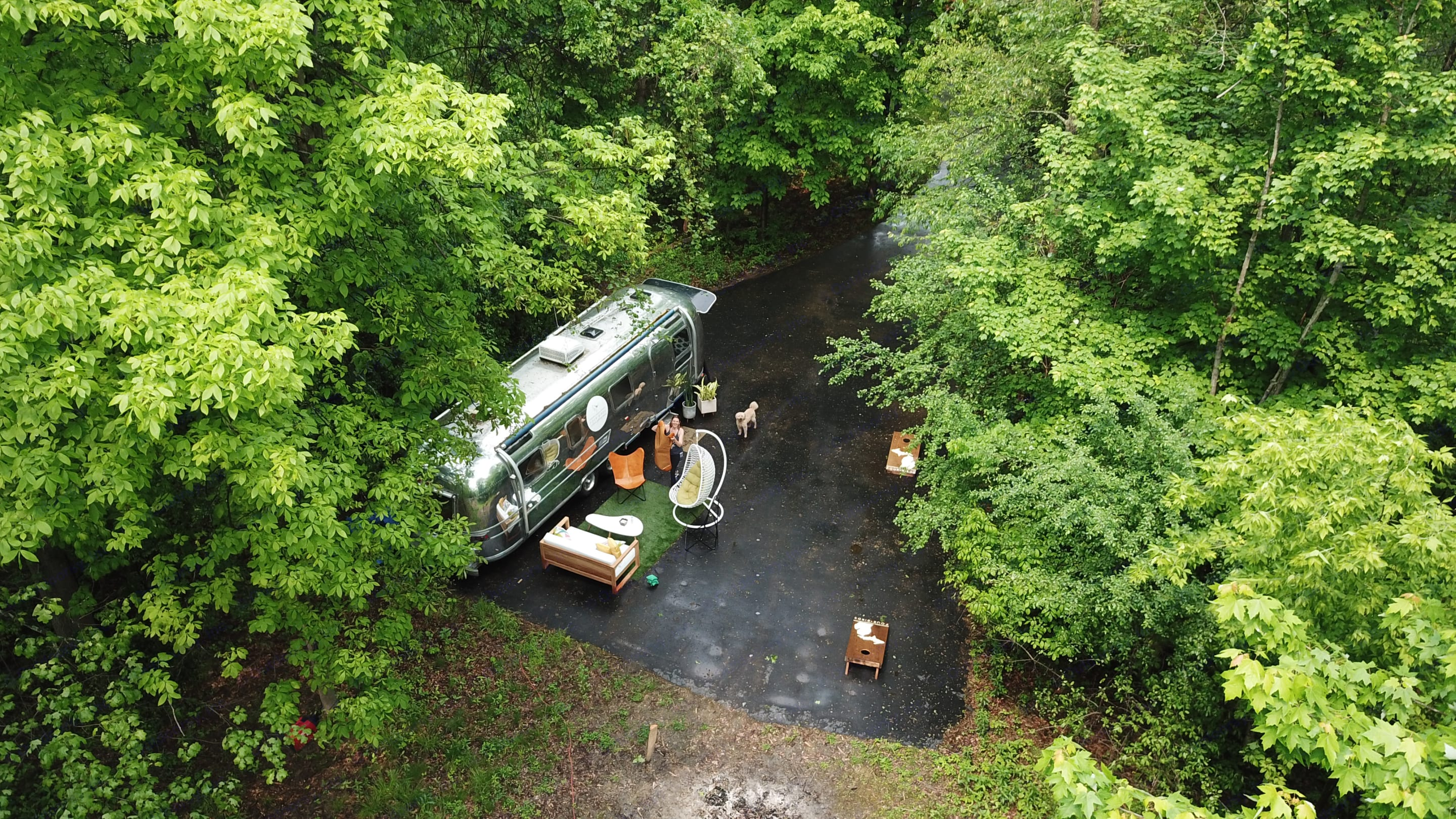 Host your gathering on 5 acres of woods near Knapps Corner in Grand Rapids, MI.. Airstream Land Yacht 1976