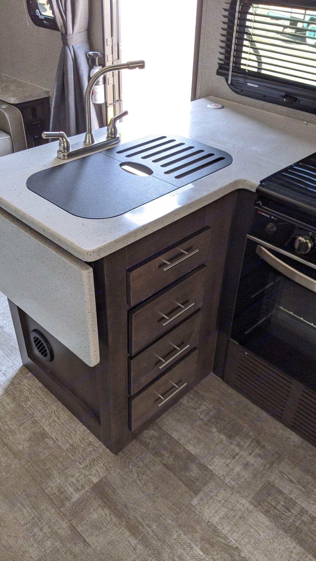 Storage under the sink. Forest River Rockwood Mini Lite 2020